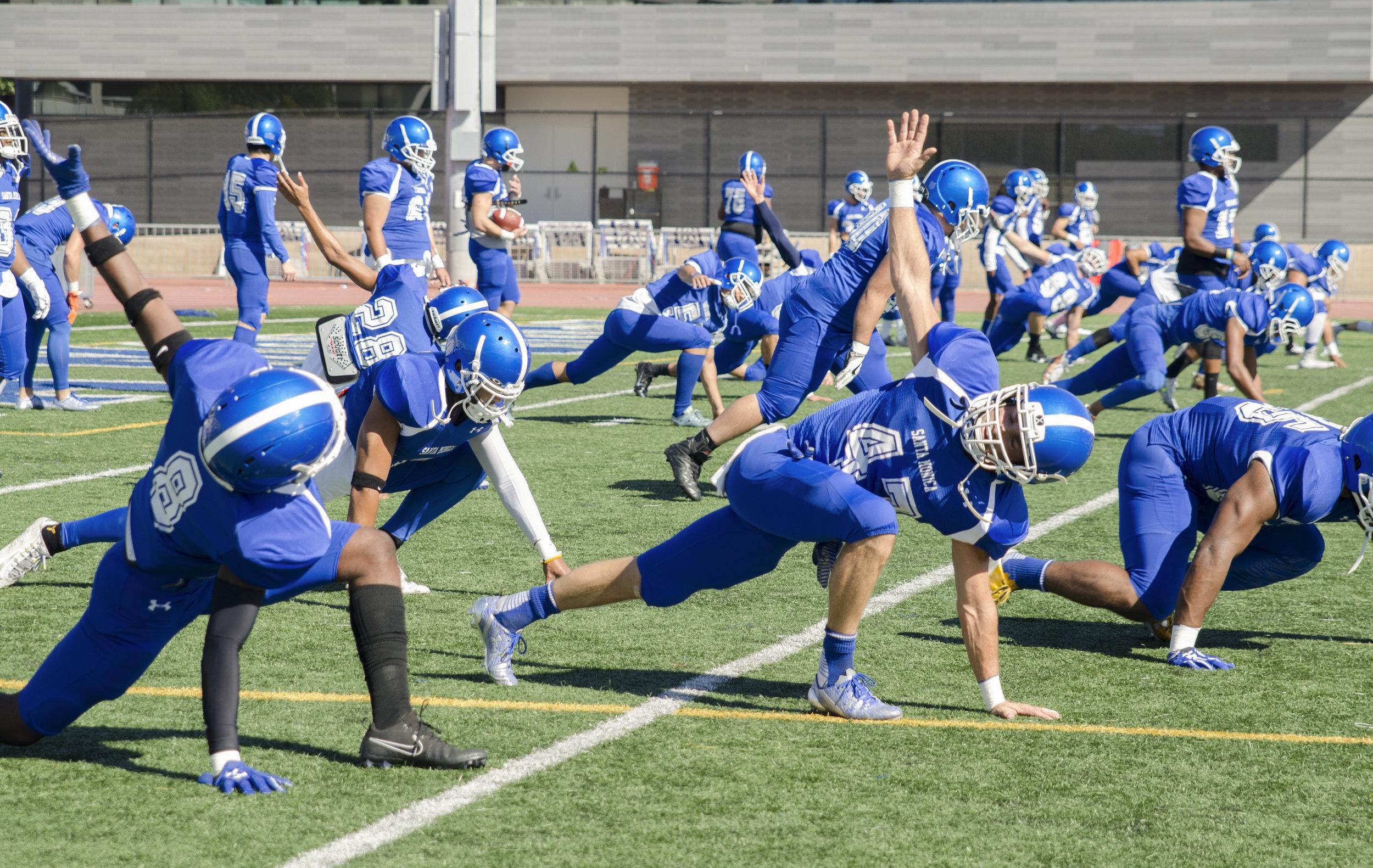 Santa Monica football players stretching and warming up before the big homecoming game. Santa Monica College football field in Santa Monica,Calif. November 4, 2017. (Photo by: Diana Parra Garcia)