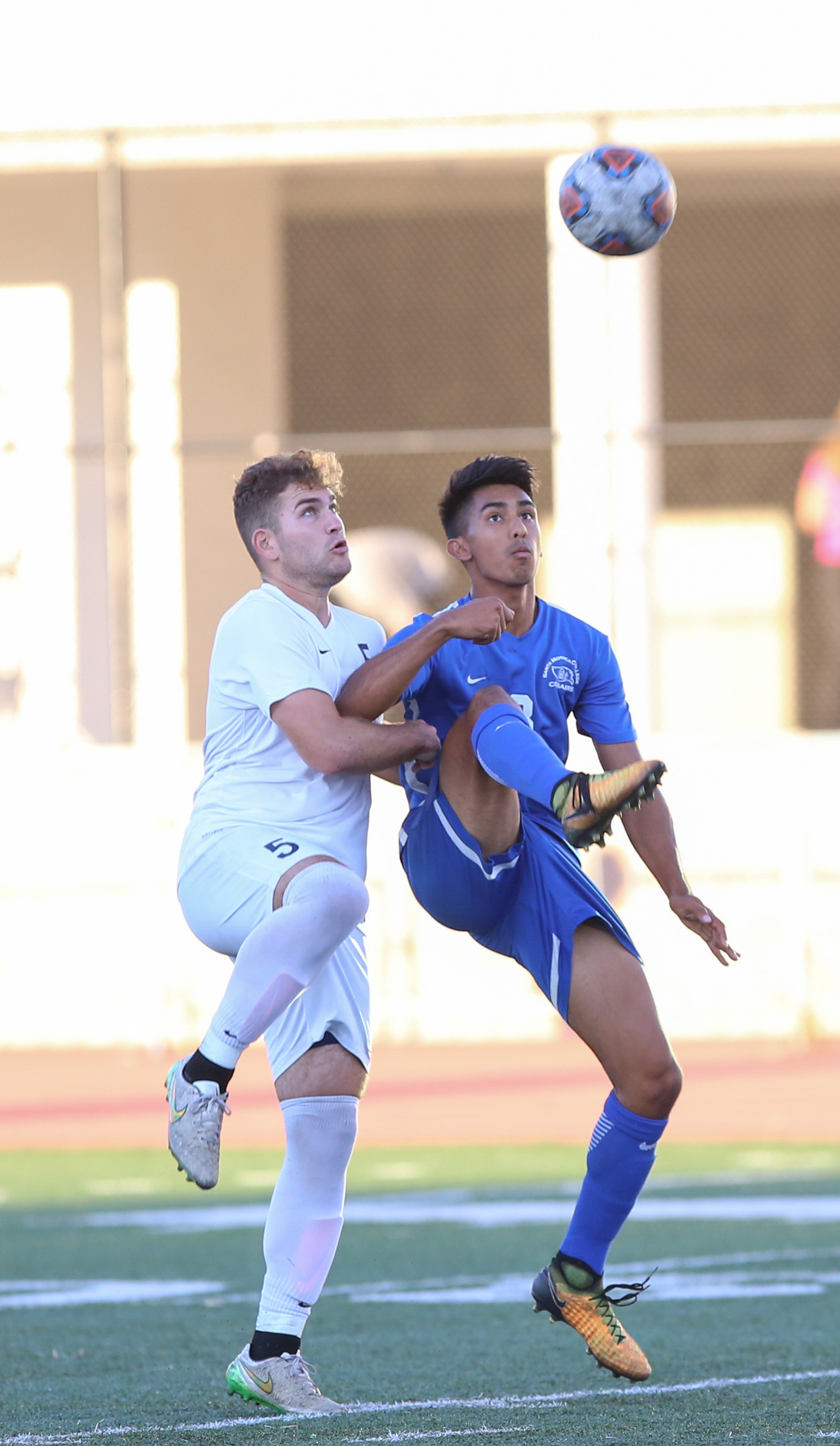 Andy Naidu (8 right) jumps to kick the ball as Elijah Patyk (5 left) lifts up his leg to kick the ball during the soccer game between Santa Monica College's Corsairs and L.A. Mission College's Eagles at the Corsair Stadium at Santa Monica College in Santa Monica, Calif on Tuesday, Nov 7th 2017. The game ended in a win for the Corsairs with a final score of 2-1. (Photo by: Thane Fernandes)