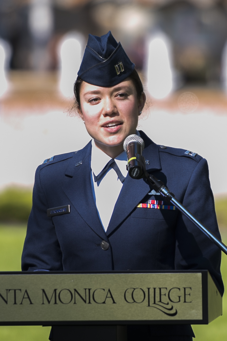 """US Air Force Captain Brittany Campbell engages the audience with some difficult memories on the field. The Veterans Day ceremony, """"Honoring Those Who Served"""", at the Santa Monica College Main Campus, by the quad, Calif. On Nov.9, 2017. Photo Clyde Bates"""
