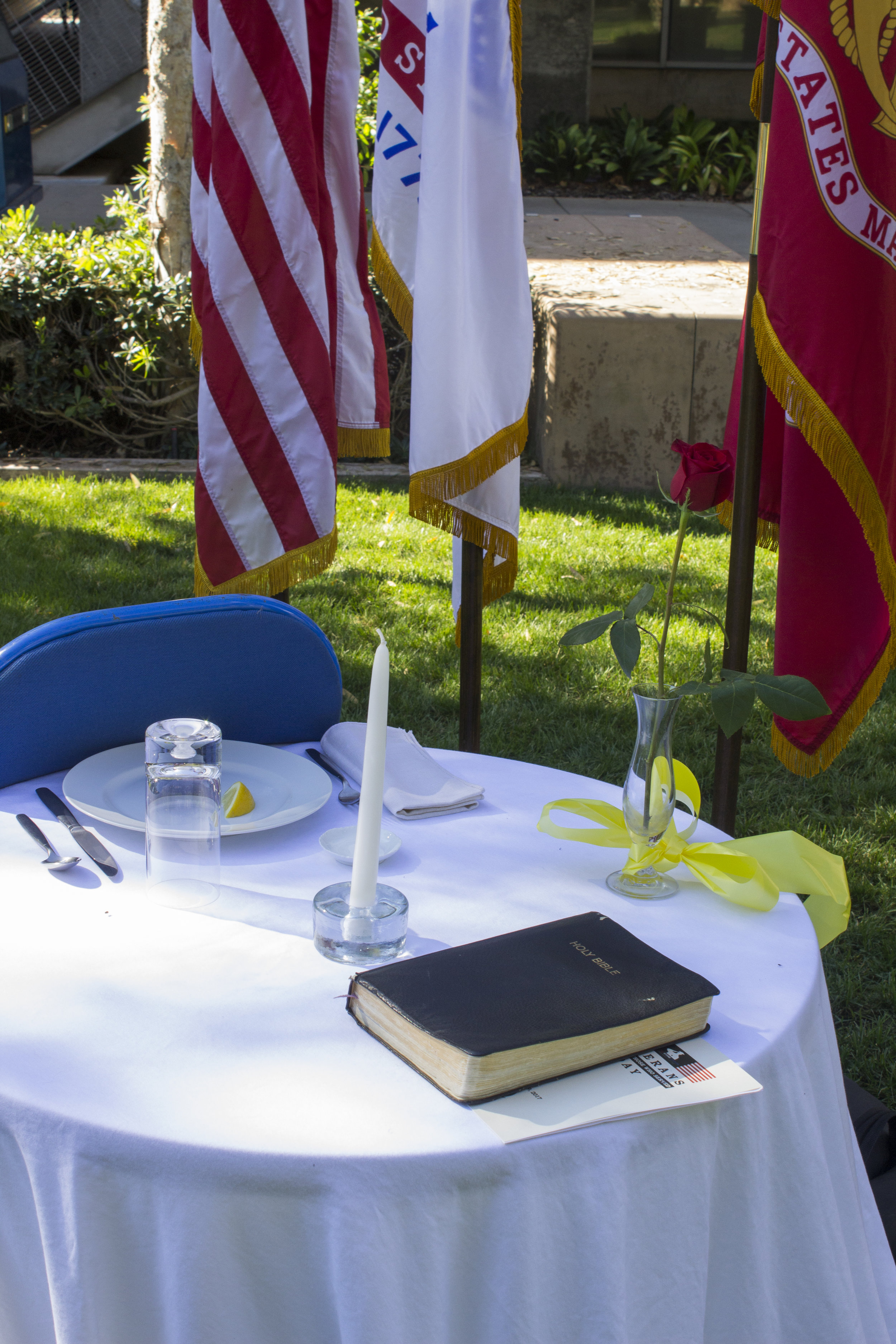 """The Missing Man Table representing fallen, missing, or imprisoned military service-members is on display during the ceremony. During the Veterans Day """"Honoring Those Who Served"""" at Santa Monica College Main Campus, by the quad, Santa Monica, Calif. On Thursday Nov.9, 2017. Photo by Emeline Moquillon."""