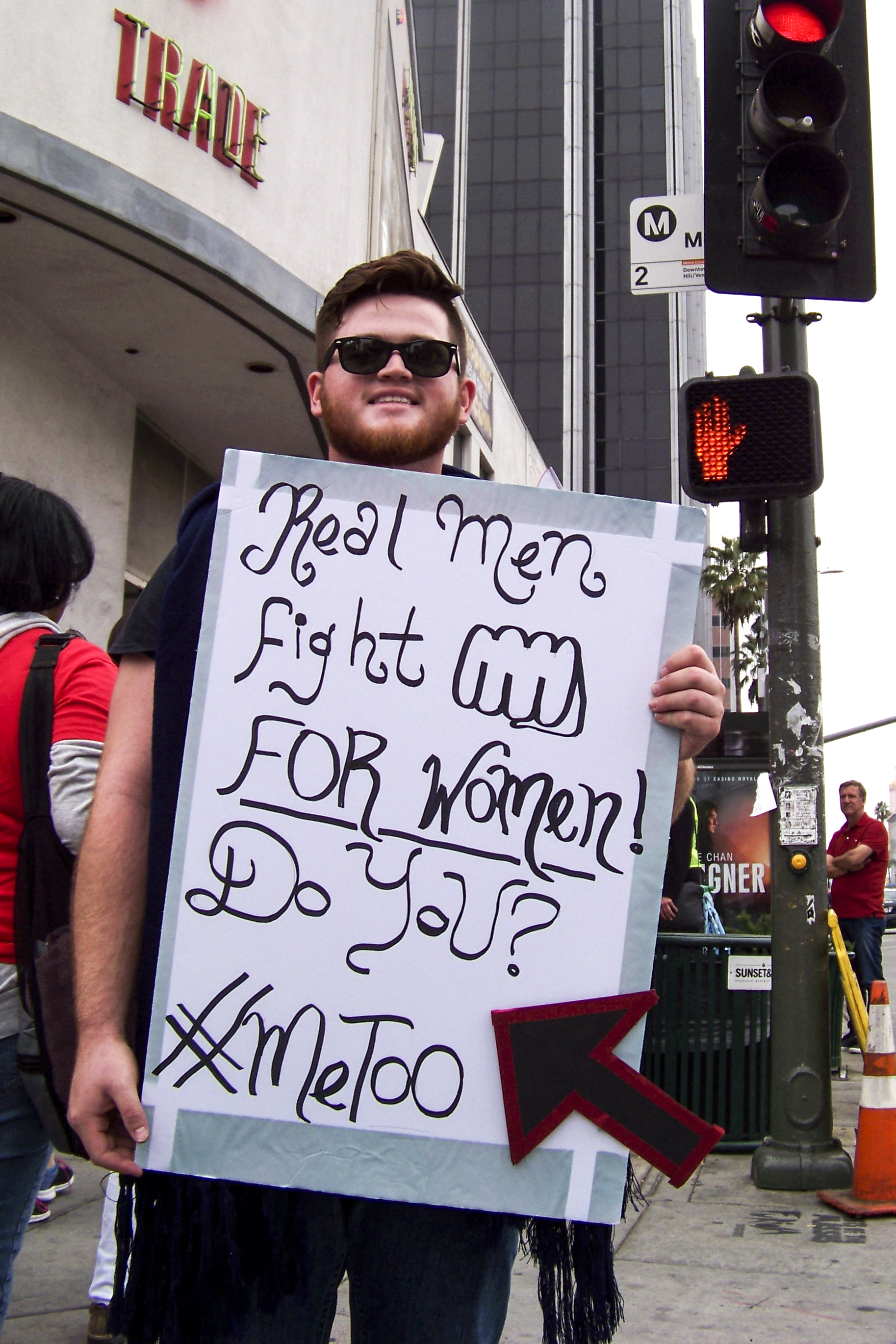 Jarred Fiorda standing proudly as a Me Too protester as he reaches the end of the march at the CNN Building on November 12, 2017 in Hollywood, Calif. (Photo by Jakob Zermeno)