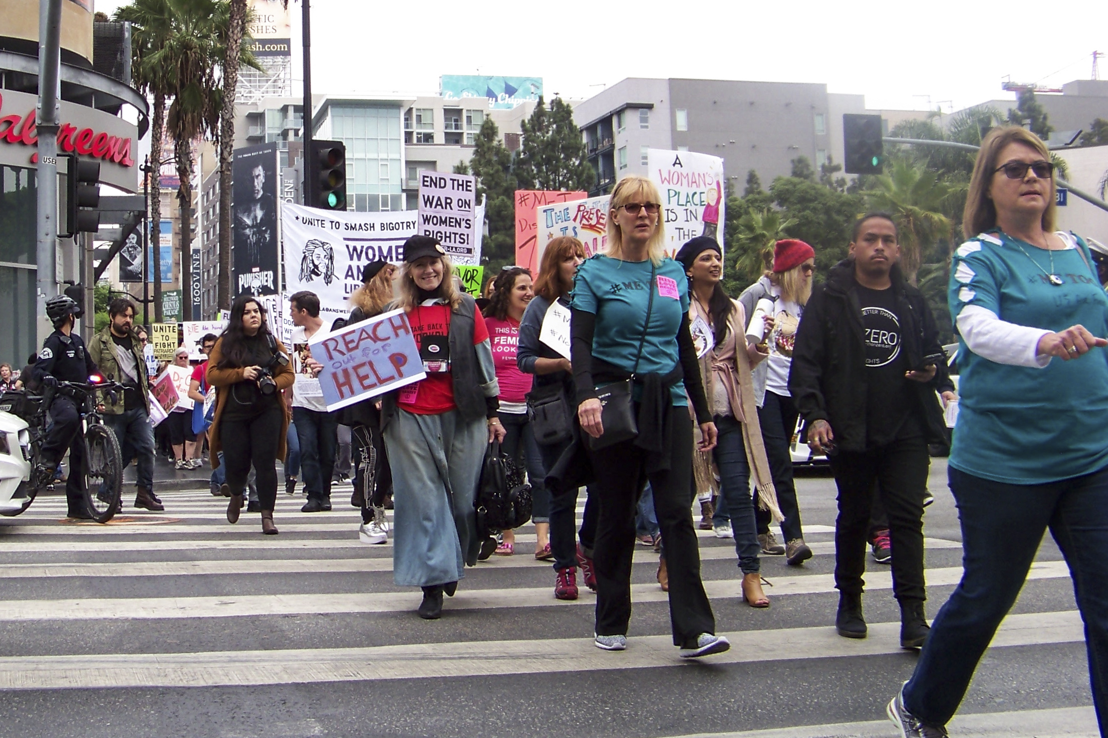 Me Too Protesters take on the final stretch of their 1 mile journey to the CNN Building still standing loud and strong on November 12, 2017 in Hollywood, Calif.  Photo by Jakob Zermeno