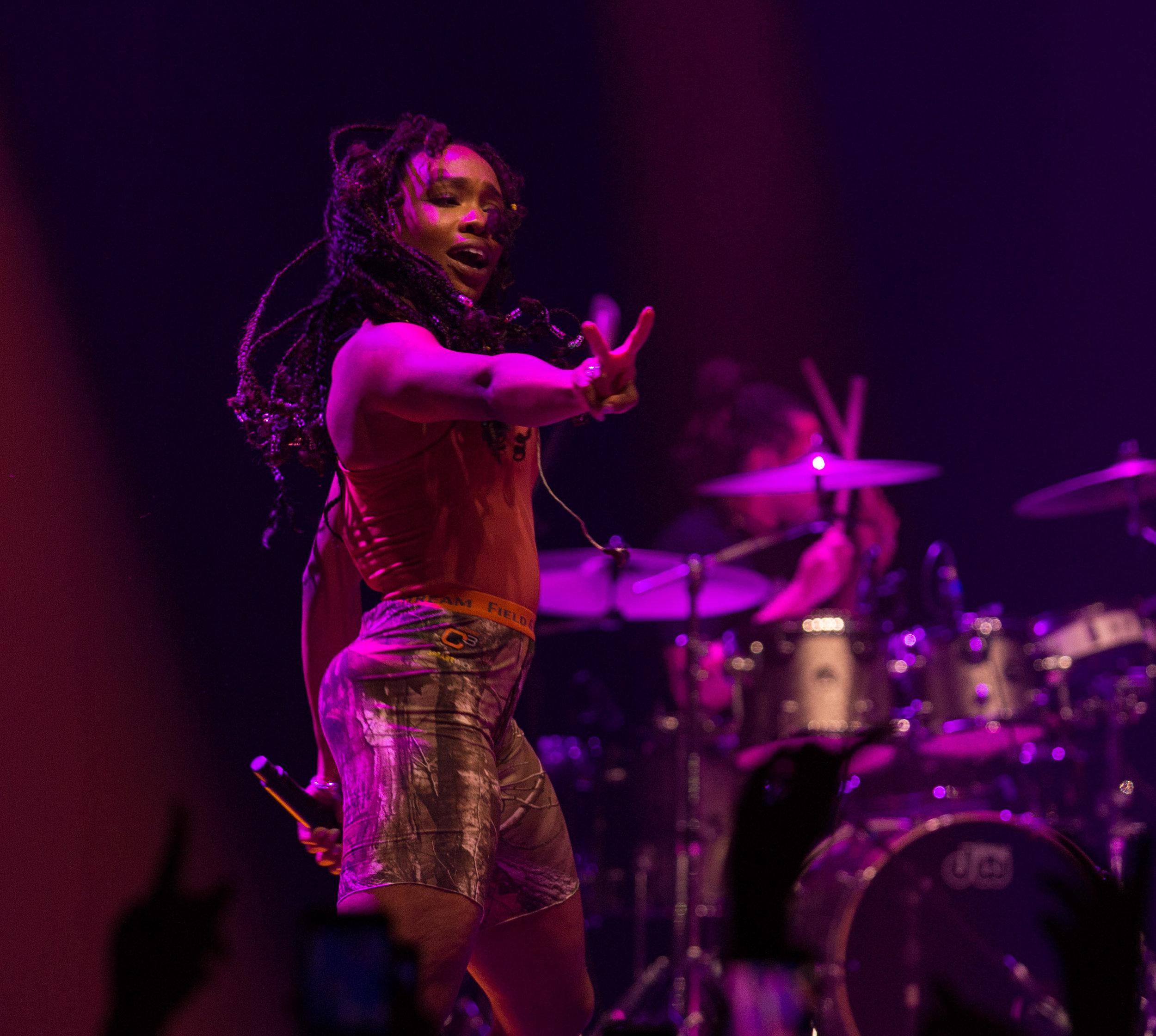 """American R&B singer Solána Imani Rowe """"SZA"""" puts up two fingers as she dances on stage during her performance of """"Prom"""" off of her debut album """"Ctrl"""" at the Novo in Los Angeles, Calif. on Tuesday, Nov. 14, 2017. The show was not originally on SZA's """"Ctrl"""" tour but was recently added due to high demand. Photo by Thane Fernandes."""