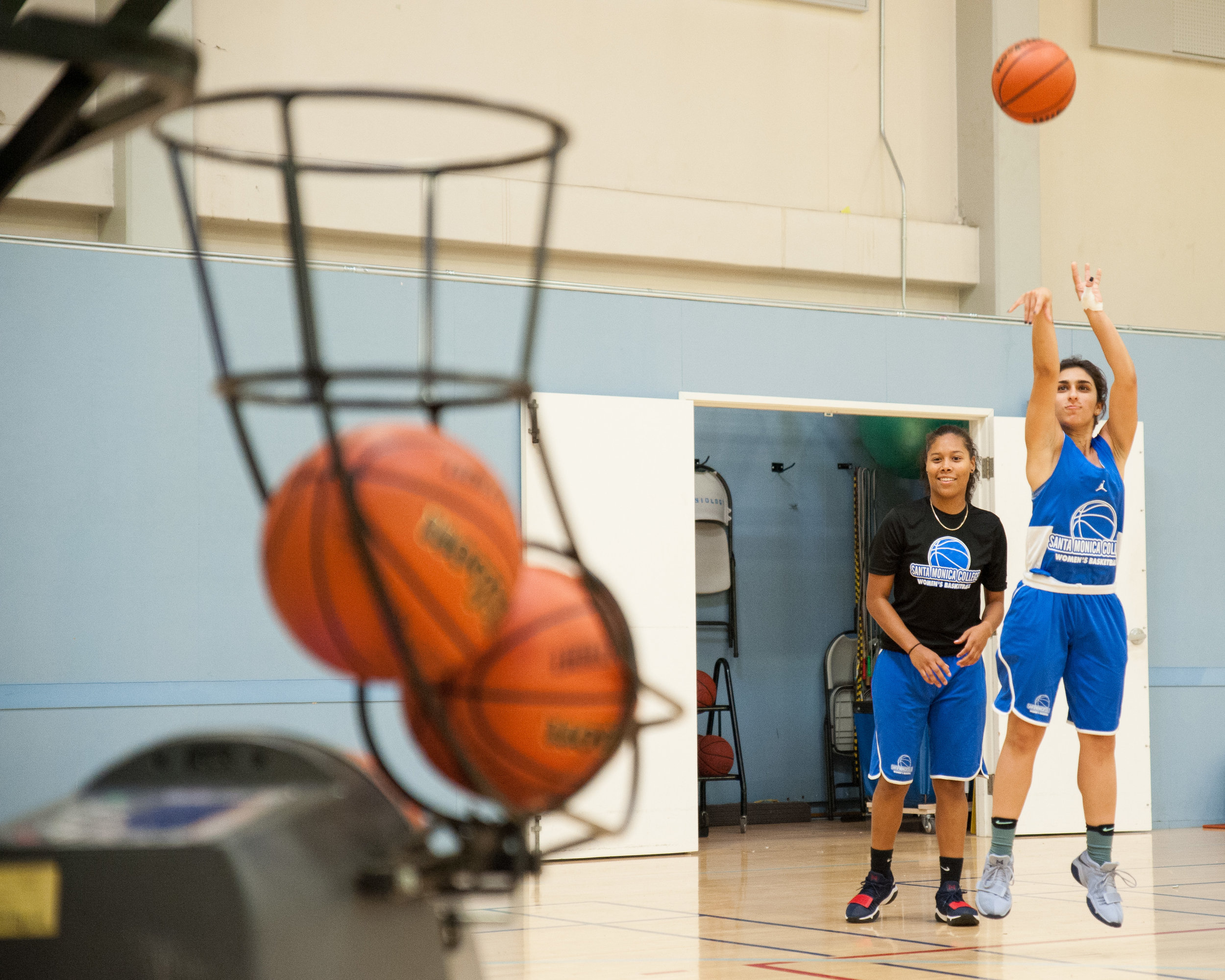 Sophmore guard Jessica Melamed (2) of the Santa Monica College Women's Basketball Team, shoots a three-pointer into a Dr. Dish machine during  practice at the SMC Pavilion. Melamed is currently leading the Corsairs in points per game in the first 2 games played with 18.5 PPG. Santa Monica College Main Campus, Santa Monica, Calif.. November 13, 2017. (Photo by: Justin Han)