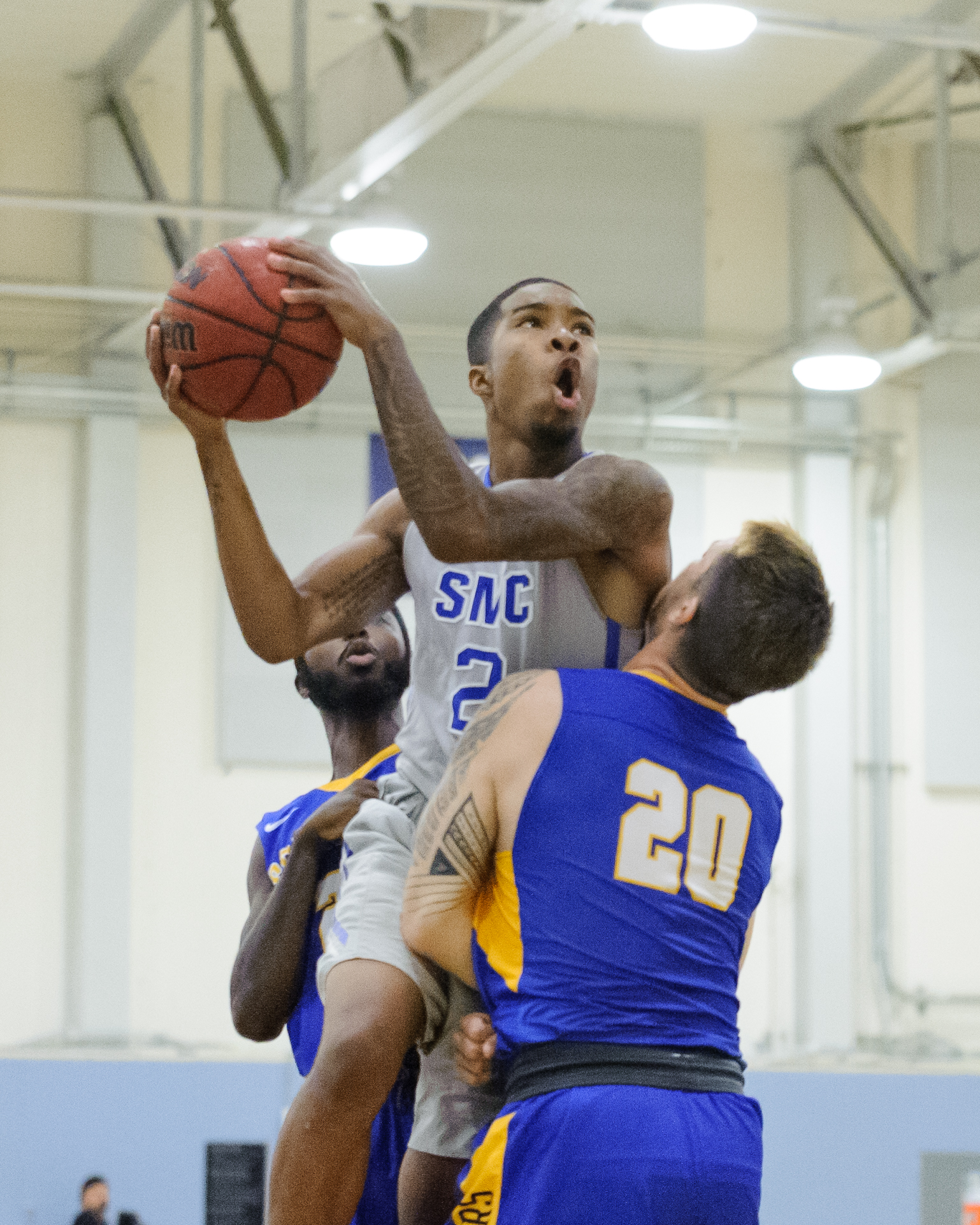 Guard Joe Robinson (2) of the Santa Monica College soars over the Southwest College defense for a shot attempt. The Santa Monica College Corsairs win their first home game of the season 84-53 against the Southwest College Cougars. The game was held at the SMC Pavilion at the Santa Monica College Main Campus in Santa Monica, Calif.. November 21, 2017.(Photo by: Justin Han/Corsair Staff)