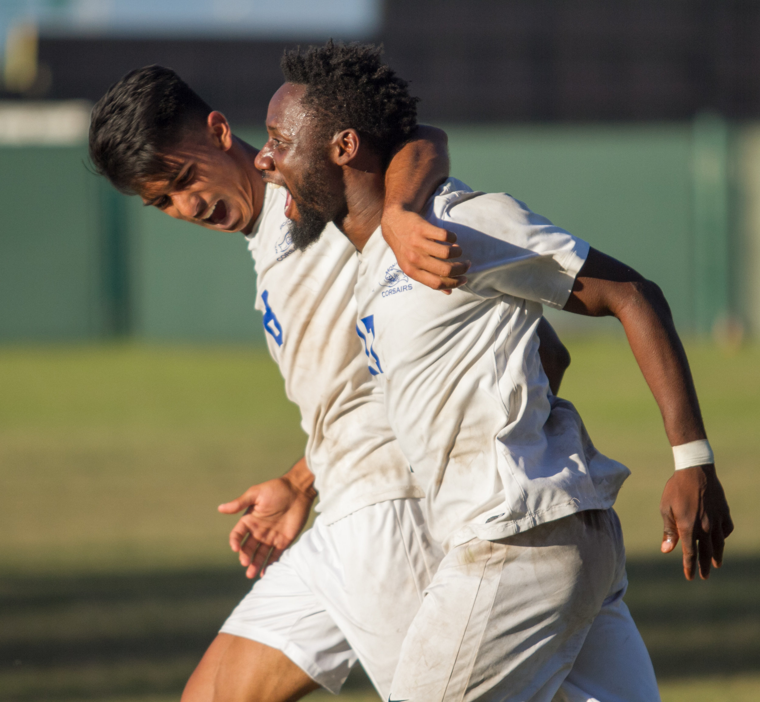 Santa Monica College Corsair Cyrille Njomo (17)(R) celebrates after scoring a goal with his teammate Chris Andy Naidu (8)(L) during the match against Cerritos College on Wednesday, November 22, 2017, at Cerritos College in Norwalk, California. The Corsairs lose 2-1. (Josue Martinez)