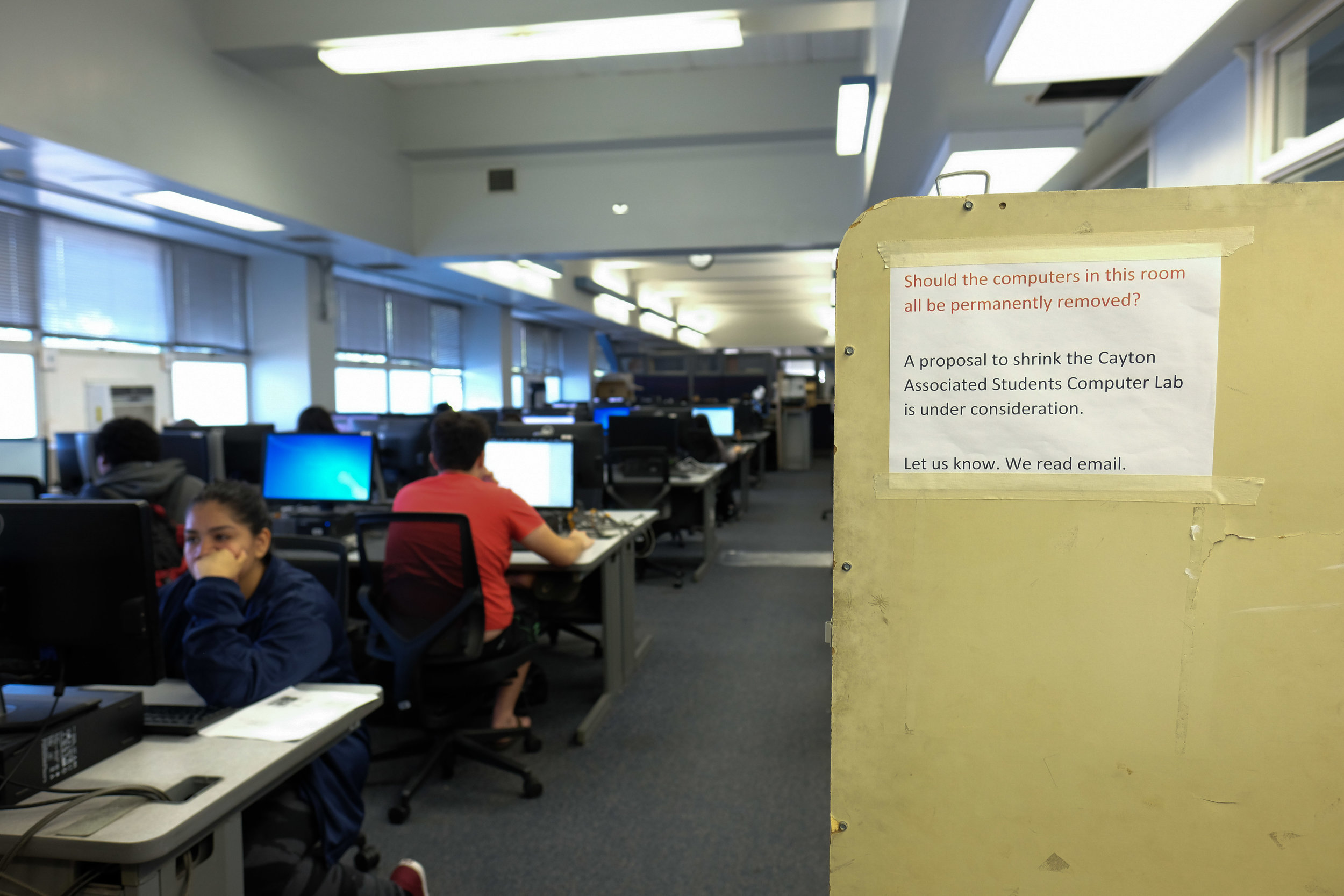 A sign posted to demonstrate the amount of workstations that would be removed in order to put the new Gender Equity Center in the Associated Students computer lab. 50 of the 82 workstations will be removed in order to put this plan into place. The Associated Students Computer lab is located at the Cayton Center on Santa Monica College's main campus in Santa Monica, CALIF on November 28, 2017. (Photo by Jayrol San Jose)