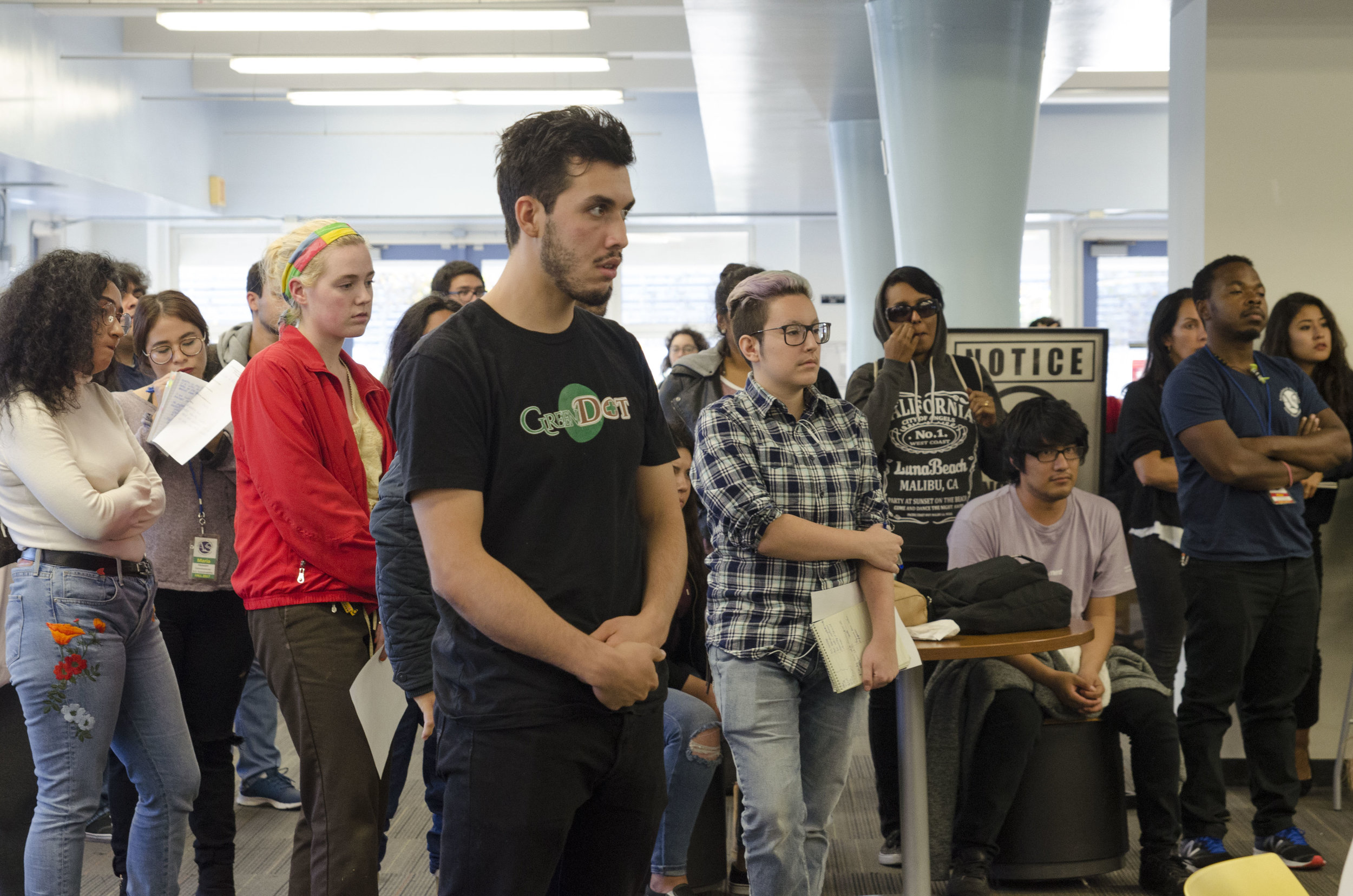 Several Santa Monica College students watch and listen to the A.S. meeting while some are lined up waiting for their chance to speak for three minutes each before the Associated Students Board during the AS meeting. Santa Monica College Cayton Center. Santa Monica, Calif. November 27, 2017. (Photo by: Diana Parra Garcia)