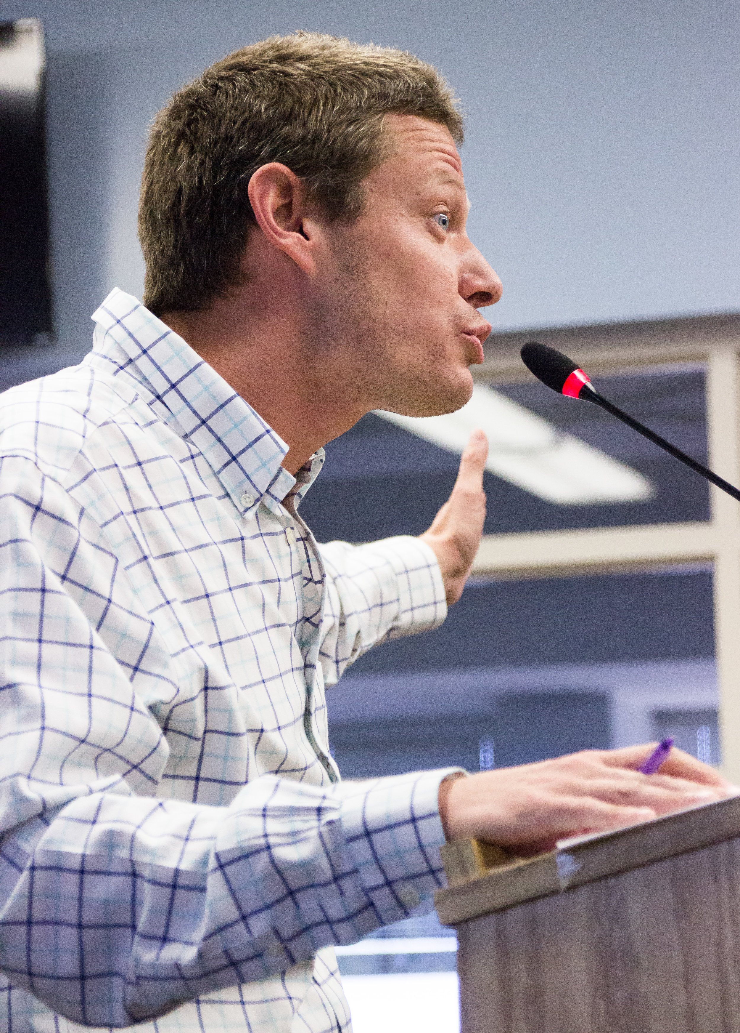 Art History Professor and Gender-Sexuality Alliance advisor, Nate Donahue, takes to the podium during the public comments section of the Associated Student Board meeting on Monday, Nov. 28, 2017, in the Cayton Center to comment on the proposal to begin construction on the Gender Equity Center in place of a portion of the Associated Students Computer Lab. (Photo By: Marisa Vasquez)