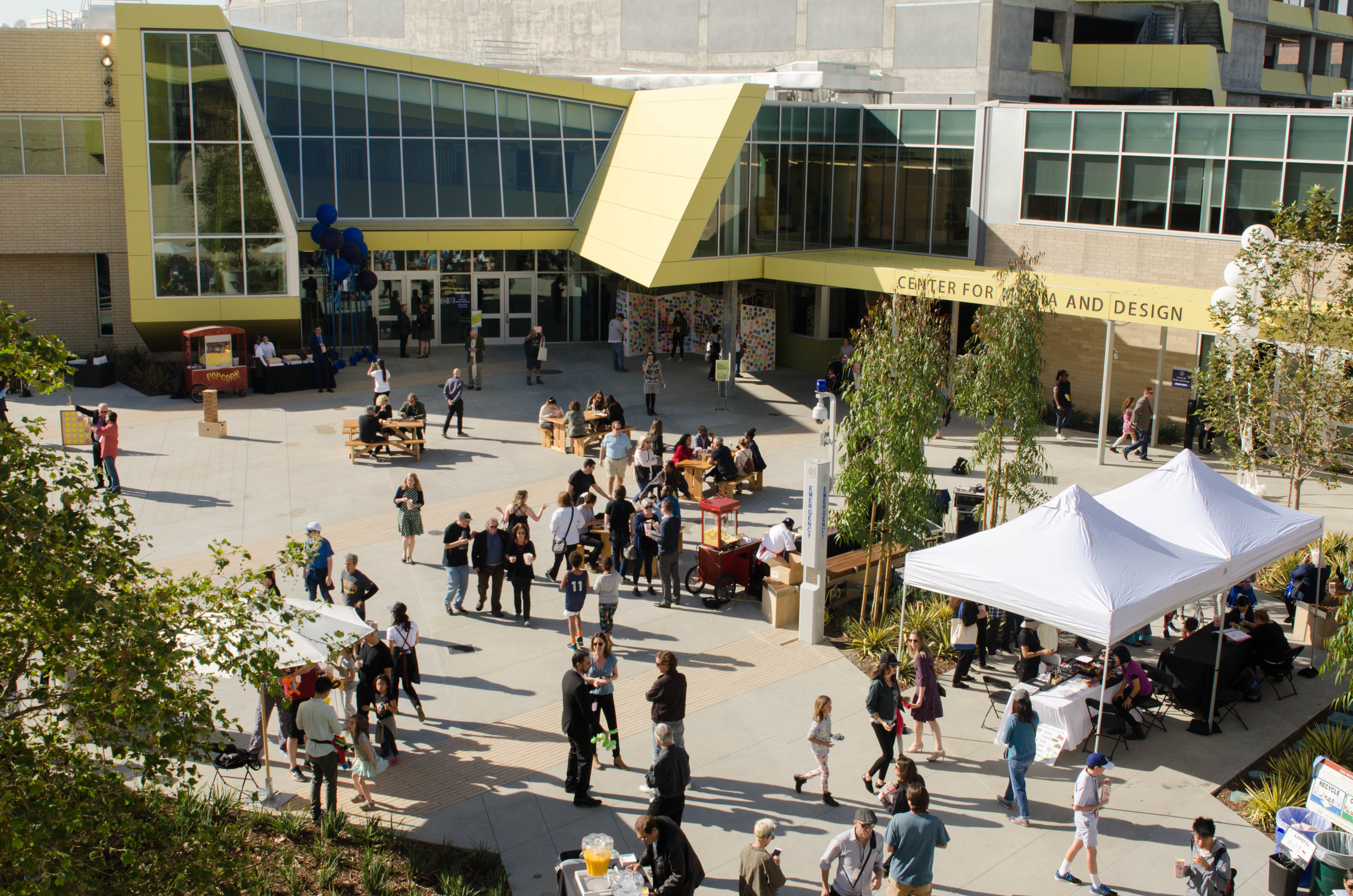 Overview of the grandopening of the Center for Media and Design. Popcorn stations,  picnic tables, face painting area, make a wish oragami notes board, giant jenga, and a drinking station. Santa Monica, Calif. December 2,2017 (Photo by: Diana Parra Garcia)