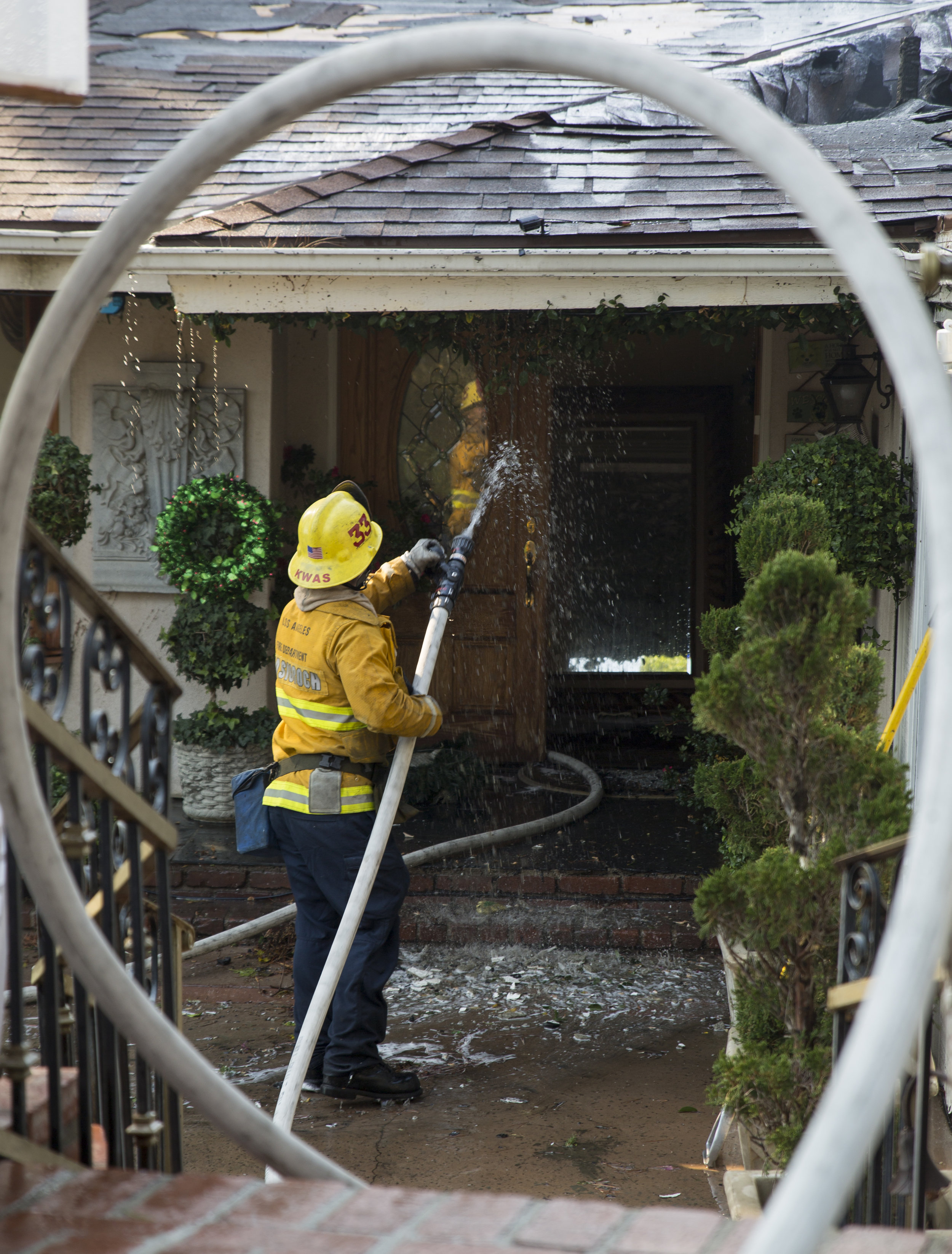 Los Angeles City firefighters fight to save one of the two homes on fire along Casiano Road in Bel-Air during the Skirball Fire on Wednesday, Dec.6, 2017 in Los Angeles, Calif. (Photo by Jose Lopez)