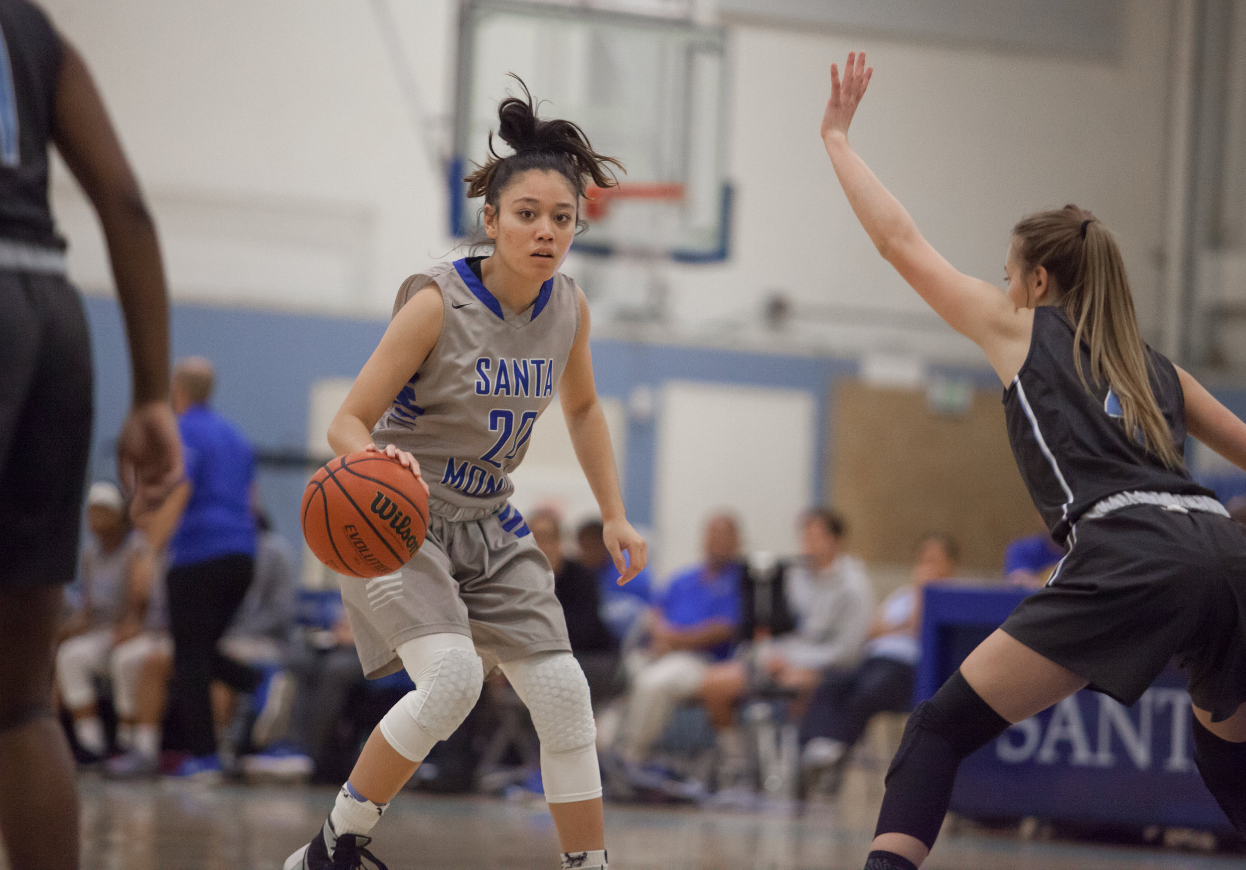 Maylene Cabral (20) of the Santa Monica College looks for an opening to create a shot while being defended by guard Kasey Nilsen (4) of the Moonpark College. The Santa Monica College Corsairs loss the home game 52-69 against the Moonpark College. The game held on Saturday, December 9th, 2017 at Santa Monica College Pavilion at Santa Monica College Main Campus in Santa Monica, California. (Photo by Elena Rybina)