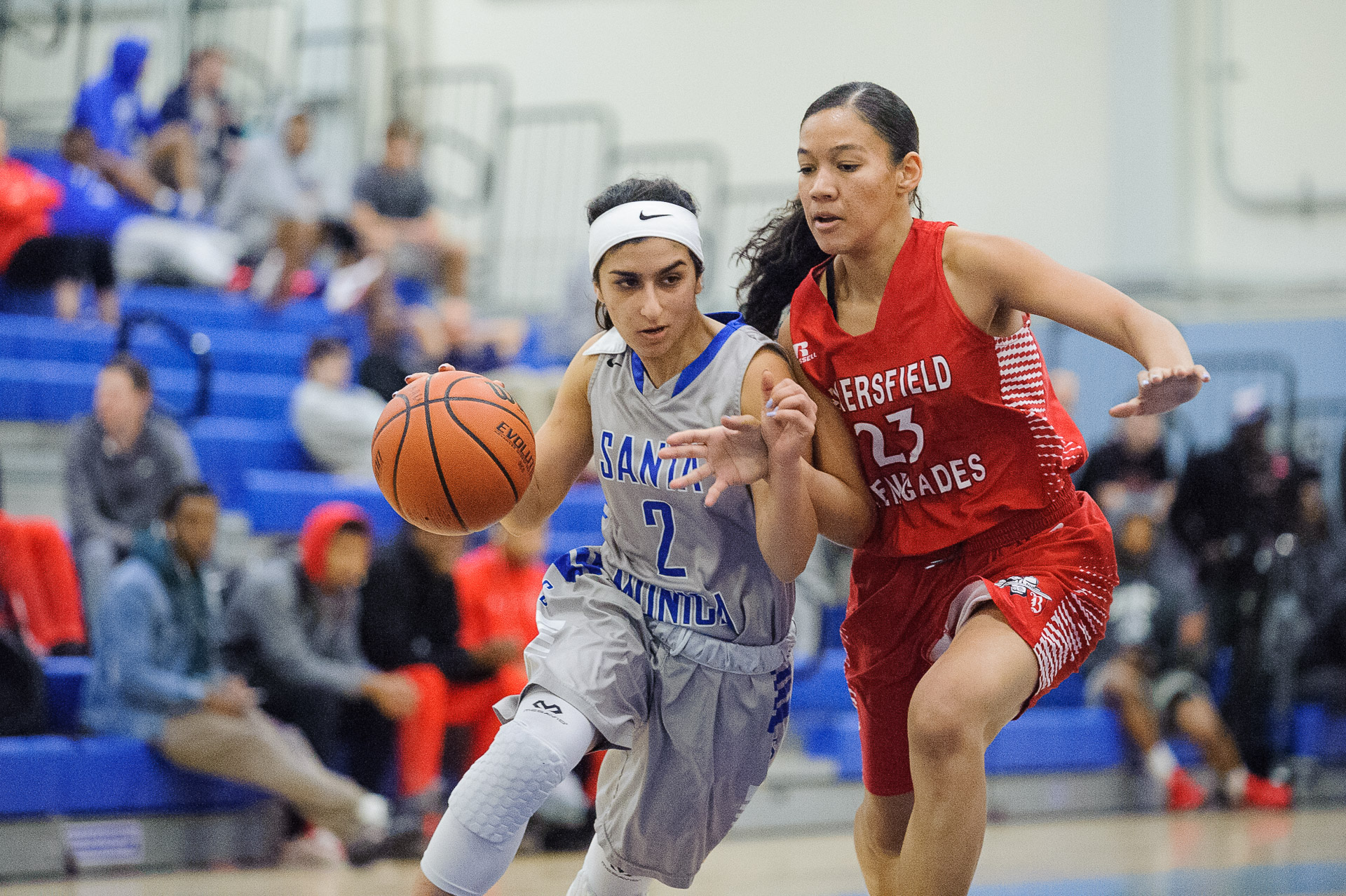 Guard Jessica Melamed (2,Left) of Santa Monica College dribbles past Octavia Croney (23,Right) of Bakersfield College. The Santa Monica College Corsairs lose the game 62-72 to the Bakersfield College Renegades. The game was held at the SMC Pavilion at the Santa Monica College Main Campus in Santa Monica, Calif.. January 20, 2018. (Photo by: Justin Han/Corsair Staff)