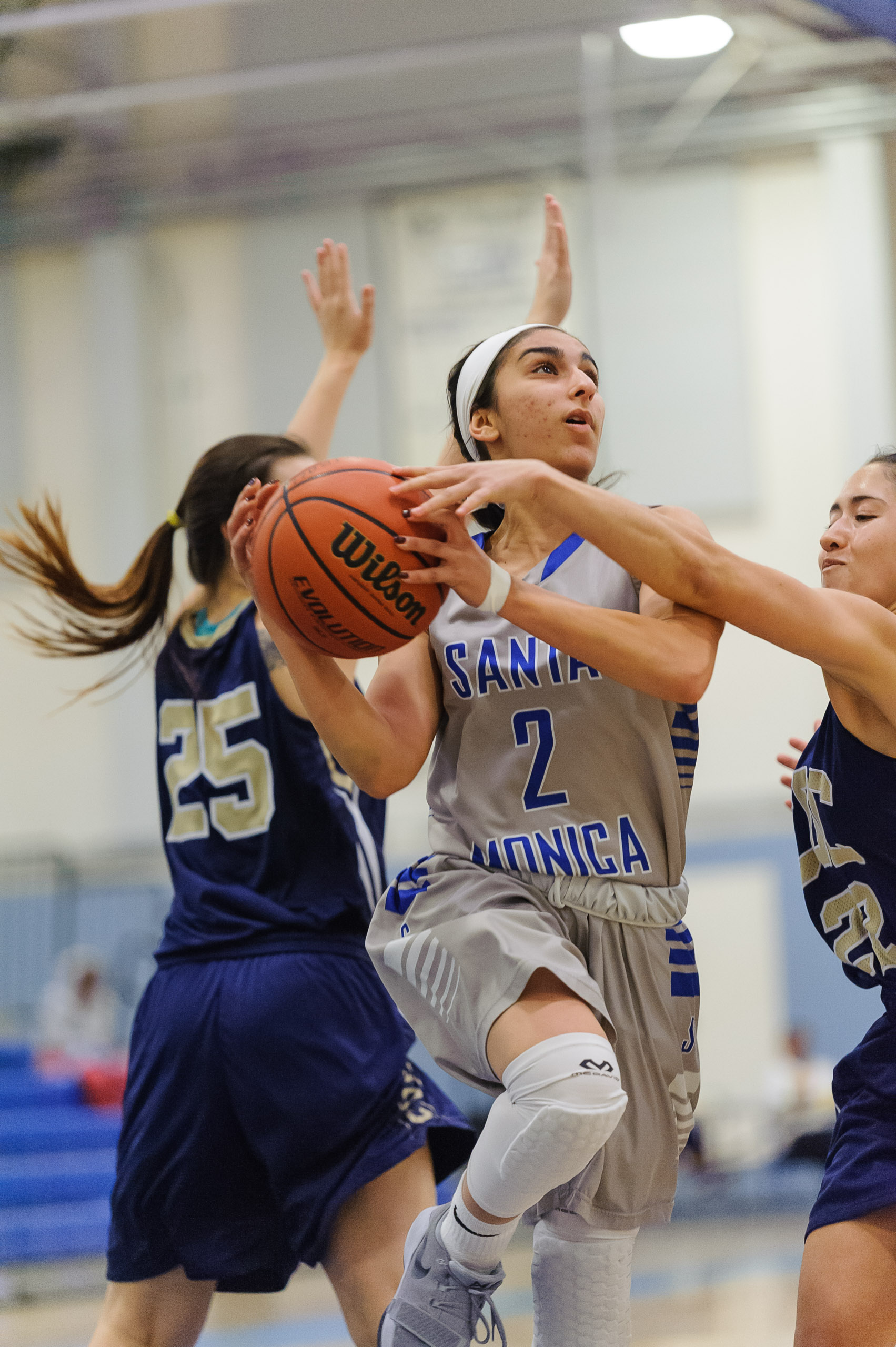 Guard Jessica Melamed (2,Middle) of Santa Monica College goes up for a layup attempt as Alexis Orellana (22,Right) of the College of the Canyons attempts to strip the ball from Melamed. The Santa Monica College Corsairs lose the game 108-70 to the College of the Canyons Cougars. The game was held at the SMC Pavilion at the Santa Monica College Main Campus in Santa Monica, Calif.. February 10, 2018. (Photo by: Justin Han/Corsair Staff)