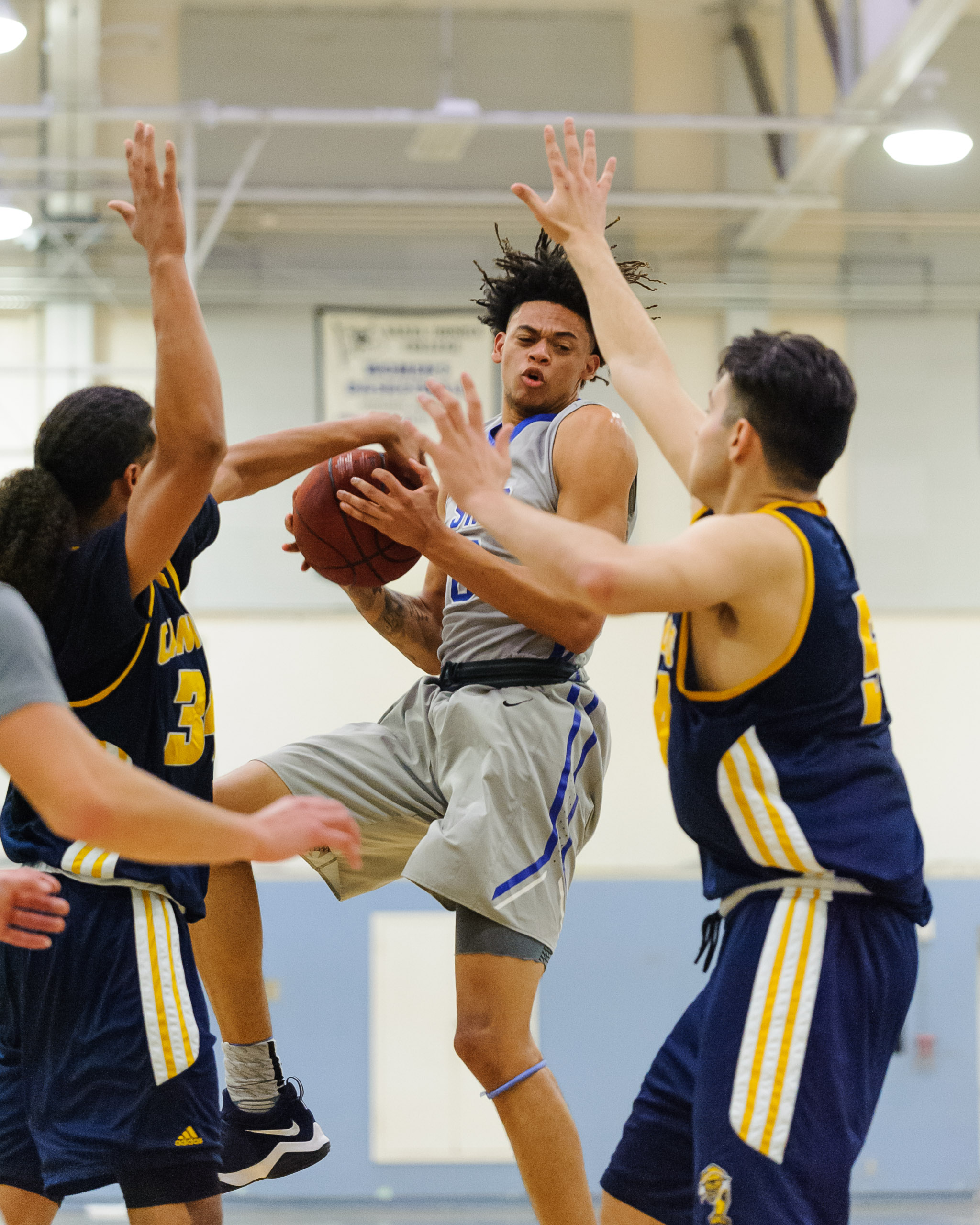 Forward Michael Fry (0) of Santa Monica College grabs an offensive rebound in traffic. The Santa Monica College Corsairs lose the game 74-72 to the College of the Canyons Cougars. The game was held at the SMC Pavilion at the Santa Monica College Main Campus in Santa Monica, Calif.. February 10, 2018. (Photo by: Justin Han/Corsair Staff)