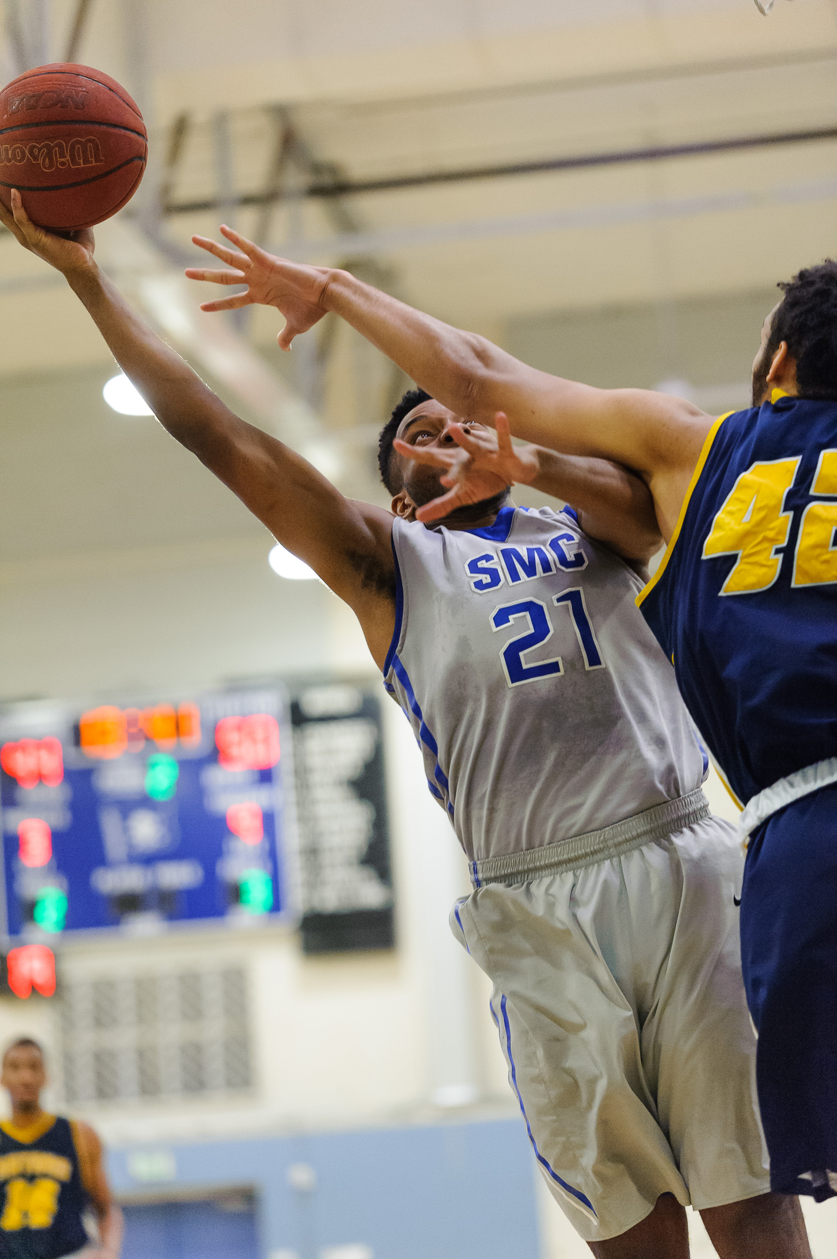 Forward Khalil Taylor (21,Left) of Santa Monica College attempts a layup while contested by Philip Webb (42,Right) of the College of the Canyons. The Santa Monica College Corsairs lose the game 74-72 to the College of the Canyons Cougars. The game was held at the SMC Pavilion at the Santa Monica College Main Campus in Santa Monica, Calif.. February 10, 2018. (Photo by: Justin Han/Corsair Staff)
