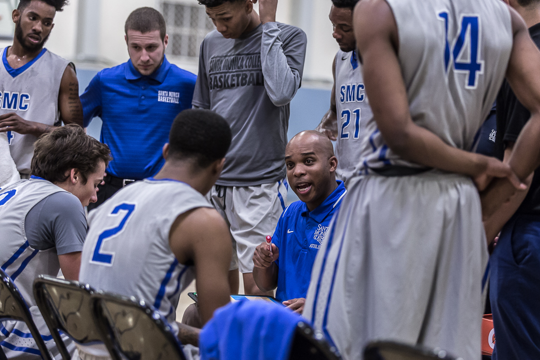 The head men's basketball coach Joshua Thomas (center) calls for a time out to regroup with his players during the last 5 minutes of the game during the Corsairs' 103-91 loss to the Pierce College Brahma Bulls at the Santa Monica College Corsair gymnasium in Santa Monica Calif., on Saturday, February 17, 2018. Photo by: Matthew Martin/Corsair Staff