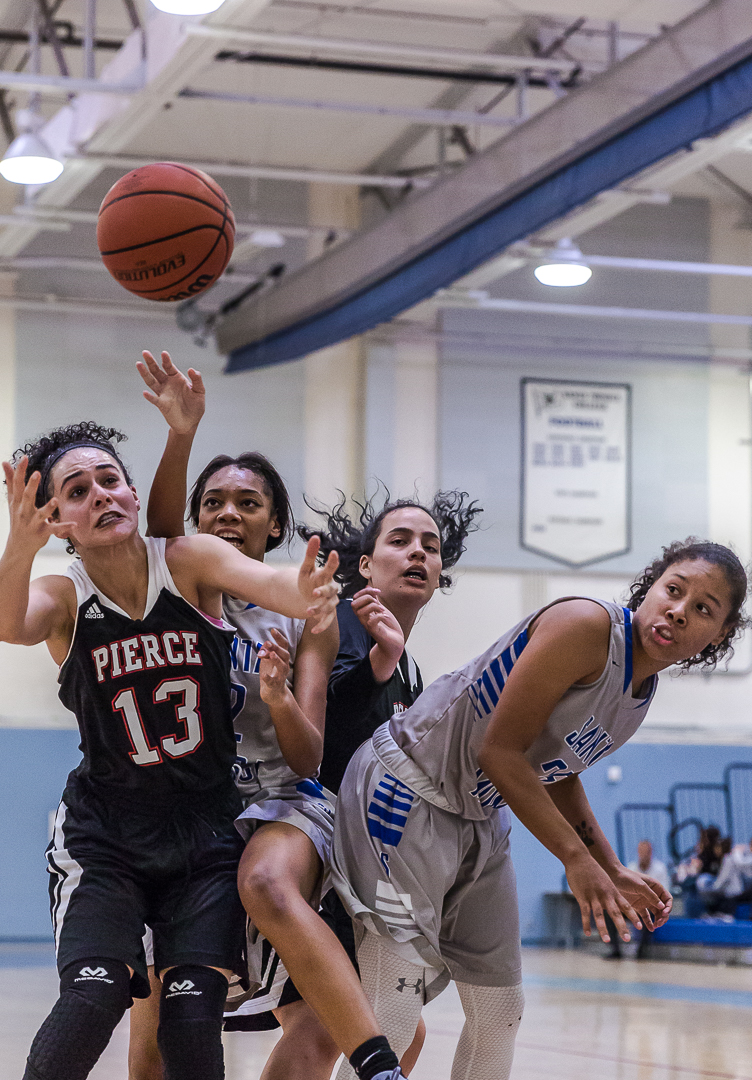 The Santa Monica Corsairs and Pierce College Brahma Bulls cluster in an attempt to fight for the rebound during the Corsairs' 76-53 win over the Pierce College Brahma Bulls at the Santa Monica College Corsair gymnasium in Santa Monica Calif., on Saturday, February 17, 2018. Photo by: Matthew Martin/Corsair Staff.