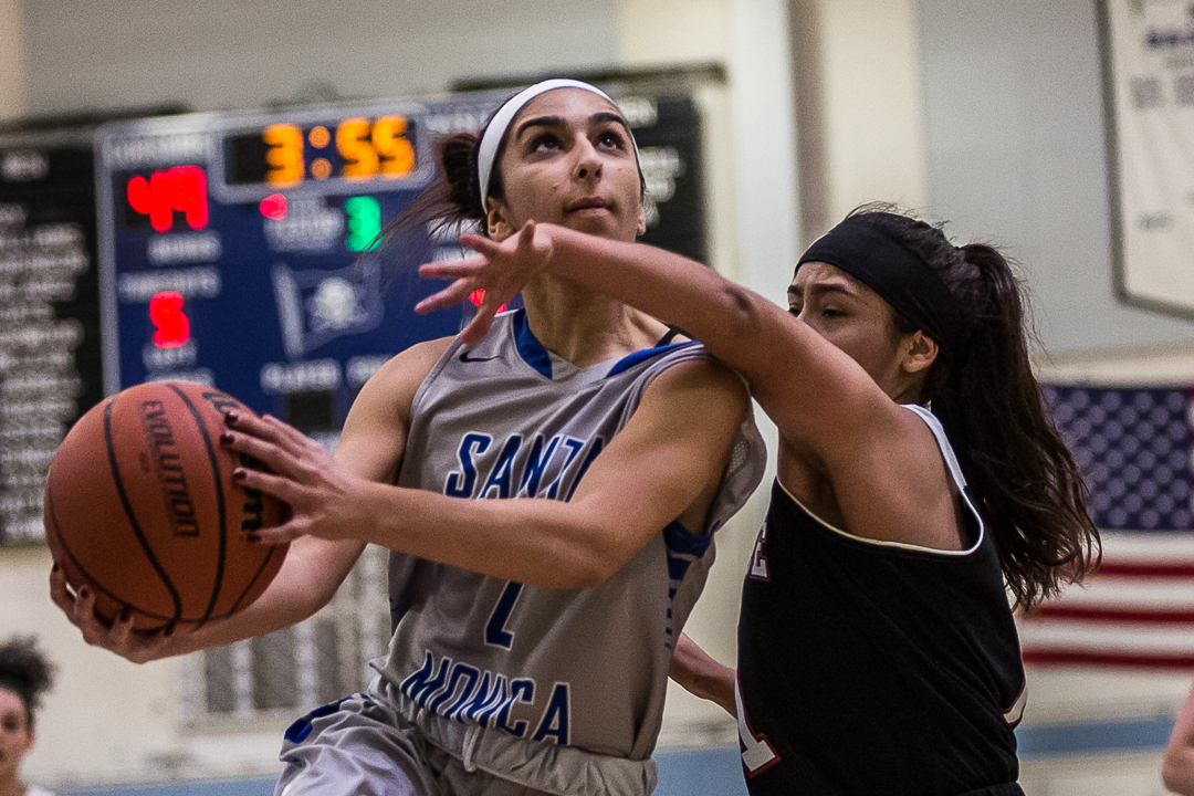 The Santa Monica College Corsair sophomore guard #2 Jessica Melamed (grey, left) goes up for the contested layup as Pierce College Brahma Bull sophomore point guard #1 Vanessa Galvez (black, right) attempts to block Melamed during the Corsairs' 76-53 win over the Pierce College Brahma Bulls at the Santa Monica College Corsair gymnasium in Santa Monica Calif., on Saturday, February 17, 2018. Photo by: Matthew Martin/Corsair Staff.