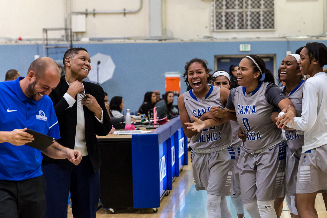 The Santa Monica College Corsair women's basketball team go to celebrate with their lead coach Lydia Strong after their 76-53 blowout victory win over the Pierce College Brahma Bulls at the Santa Monica College Corsair gymnasium in Santa Monica Calif., on Saturday, February 17, 2018. Photo by: Matthew Martin/Corsair Staff