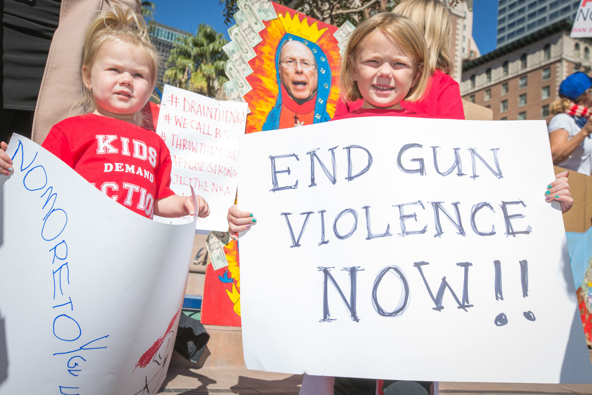 Hundreds of peaceful protestors gathered in Downtown Los Angeles, while some parents brought their children, most holding signs, as speakers took to the podium to talk about stricter gun control laws in the U.S. on Monday February 19, 2018. Pershing Square, Los Angeles Calif.. (Photo By: Daniel Bowyer)