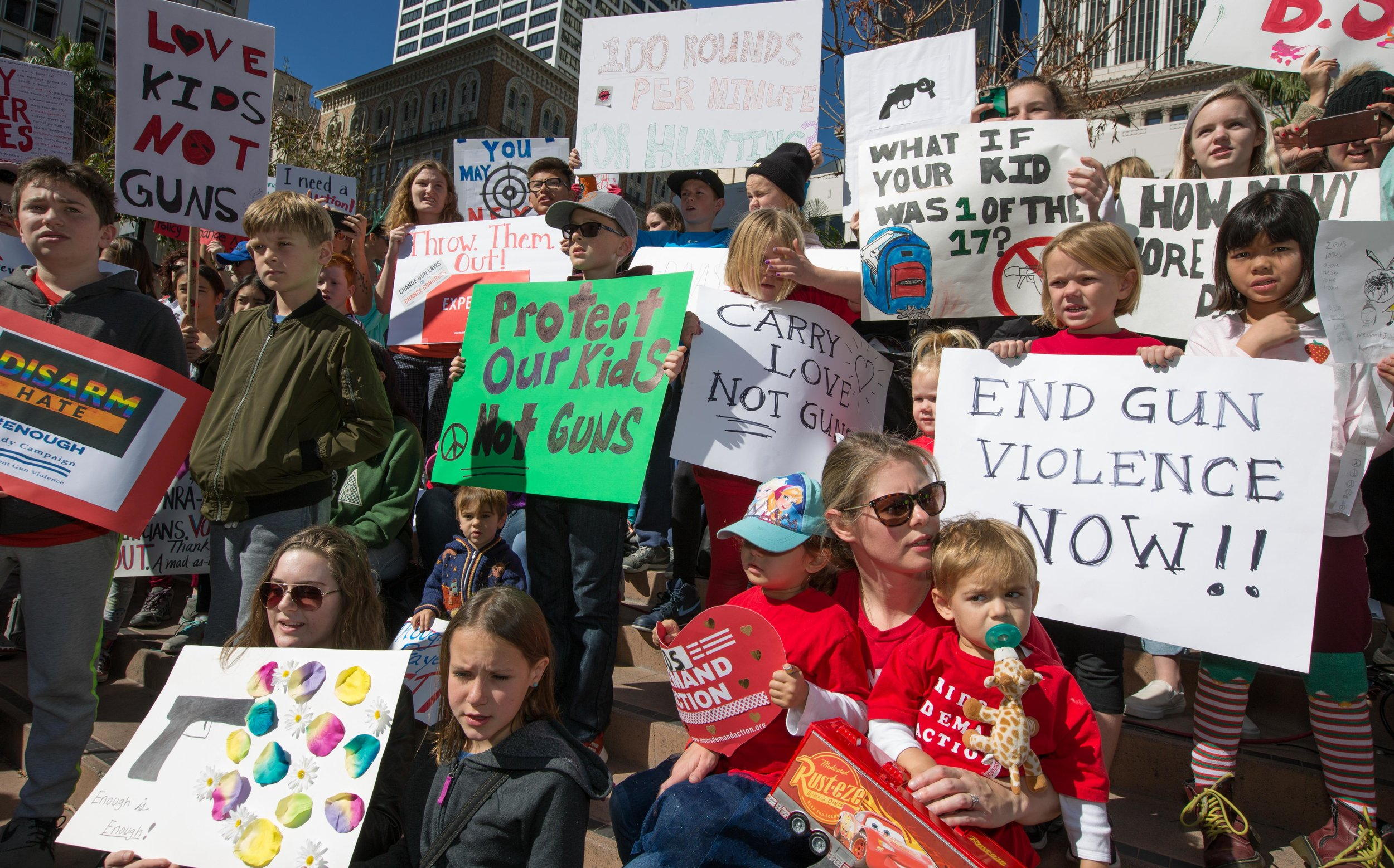 Hundreds of peaceful protestors gathered in Downtown Los Angeles, while some brought their children, most holding signs, as speakers took to the podium to talk about stricter gun control laws in the U.S. on Monday February 19, 2018. Pershing Square, Los Angeles Calif.. (Photo By: Daniel Bowyer)