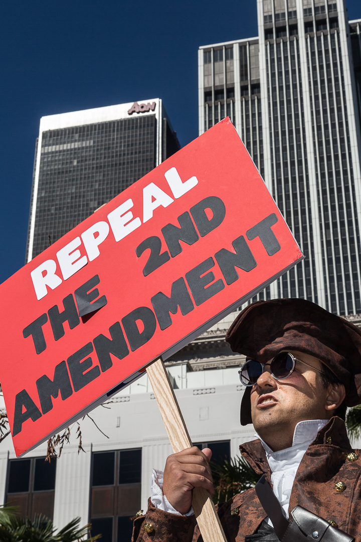 """Konstantine Anthony, dressed as a historical militia member, holds a sign that reads, """"repeal the 2nd amendment"""" during The People's Rally Against Gun Violence at Pershing Square Park in downtown Los Angeles, Monday February 19, 2018.About 500 people attended the anti-gun violence rally chanting slogans like """"Drain the NRA,"""" where members from the groups Moms Demand Action Drain the NRA say they are standing in solidarity with parents, students and other supporters in Parkland, Fla., where 17 students and faculty members were killed inside a high school last week by a 19-year-old gunman with a semi-automatic rifle."""