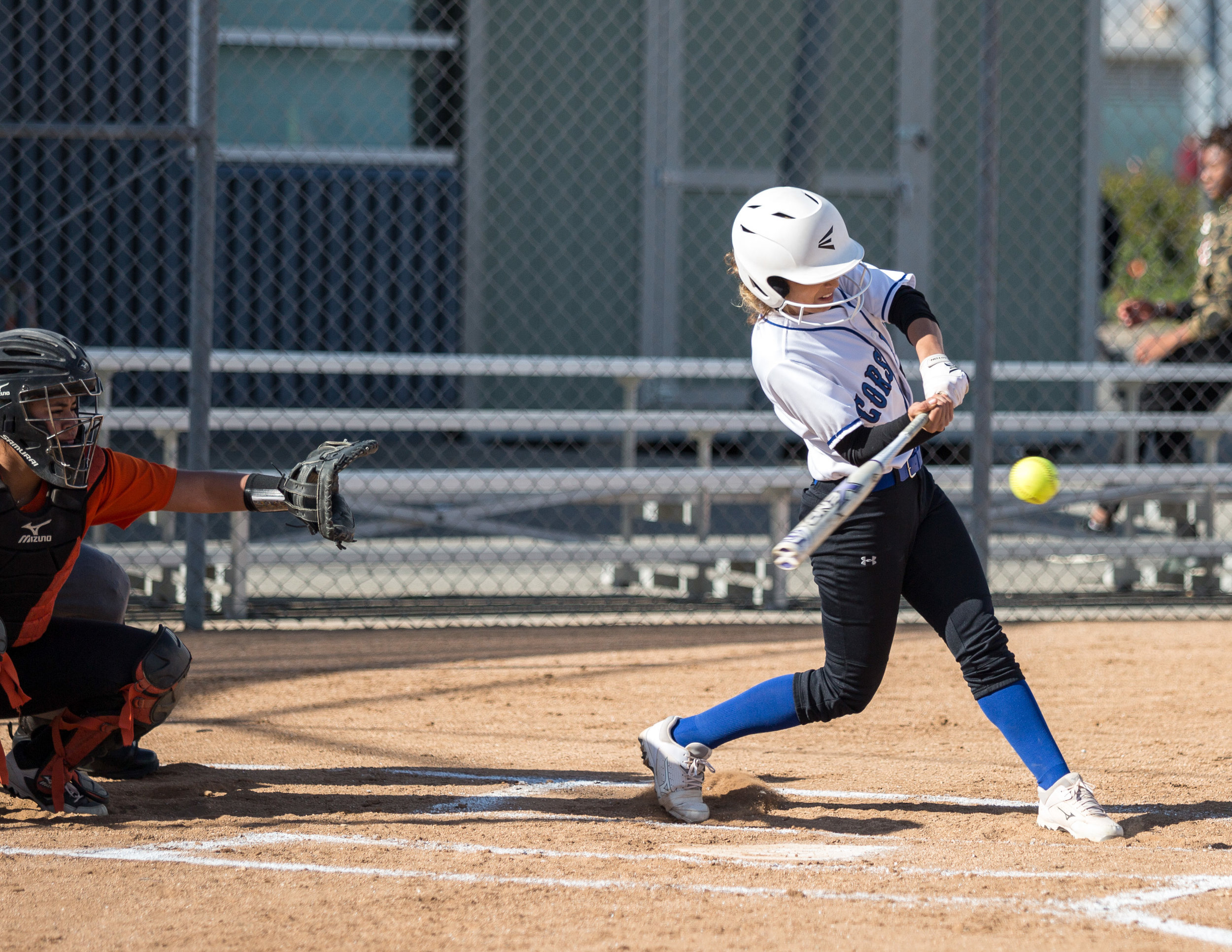 Santa Monica College Corsair freshman infielder Taylor Liebesman #23 (white, right) hits a double during the top of the 2rd at the Corsair Field in Santa Monica California, on Tuesday, February 27 2018. The Corsairs would go on to lose the game 0-14 against the Ventura College Pirates. (Corsair Photo: Matthew Martin)