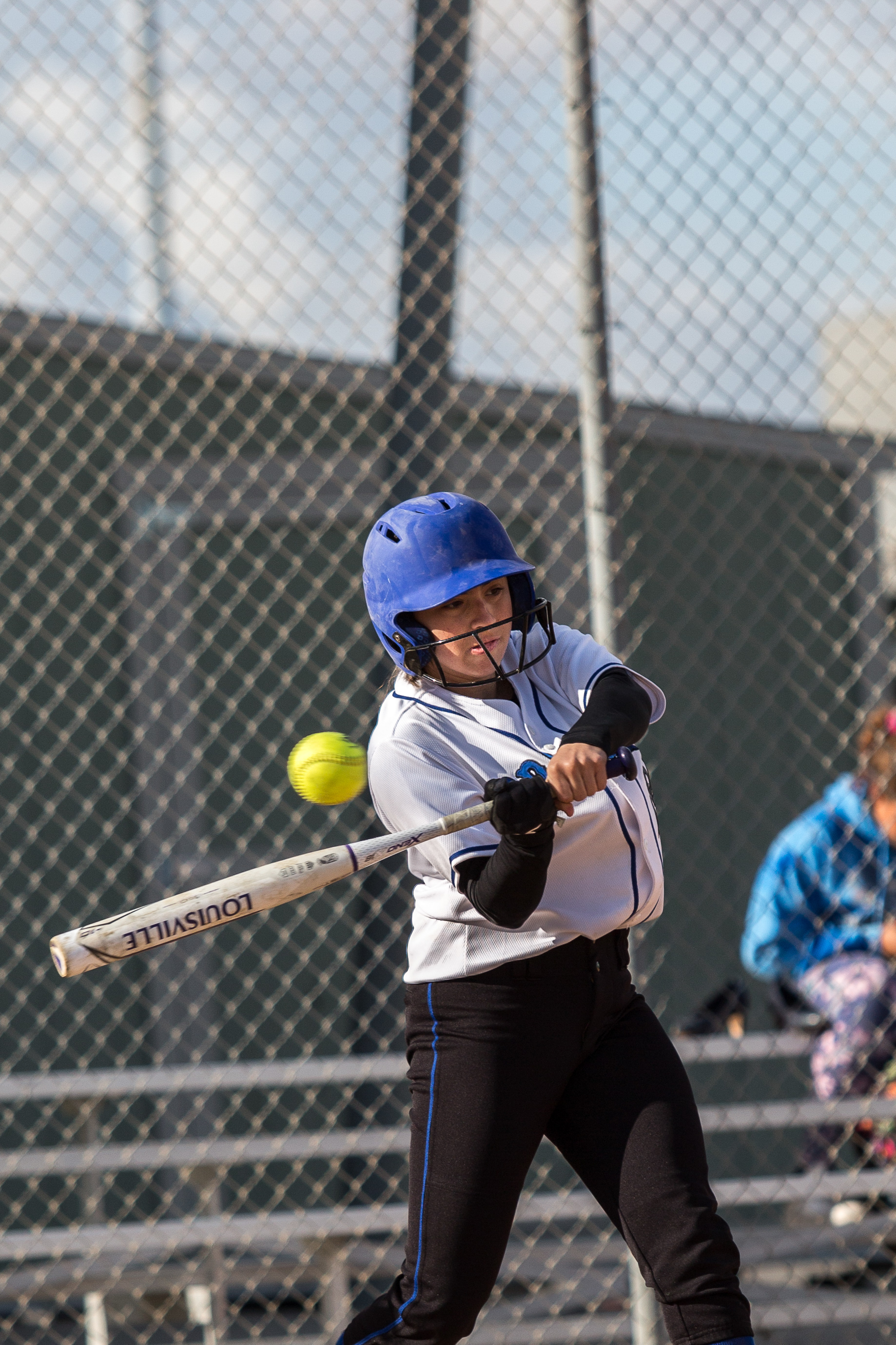 Santa Monica College Corsair freshman outfielder Aliza Chacon (#24, white) hits a single at the bottom of the 3rd at the Corsair Field in Santa Monica California, on Tuesday, February 27 2018. The Corsairs would go on to lose the game 0-14 against the Ventura College Pirates. (Corsair Photo: Matthew Martin)