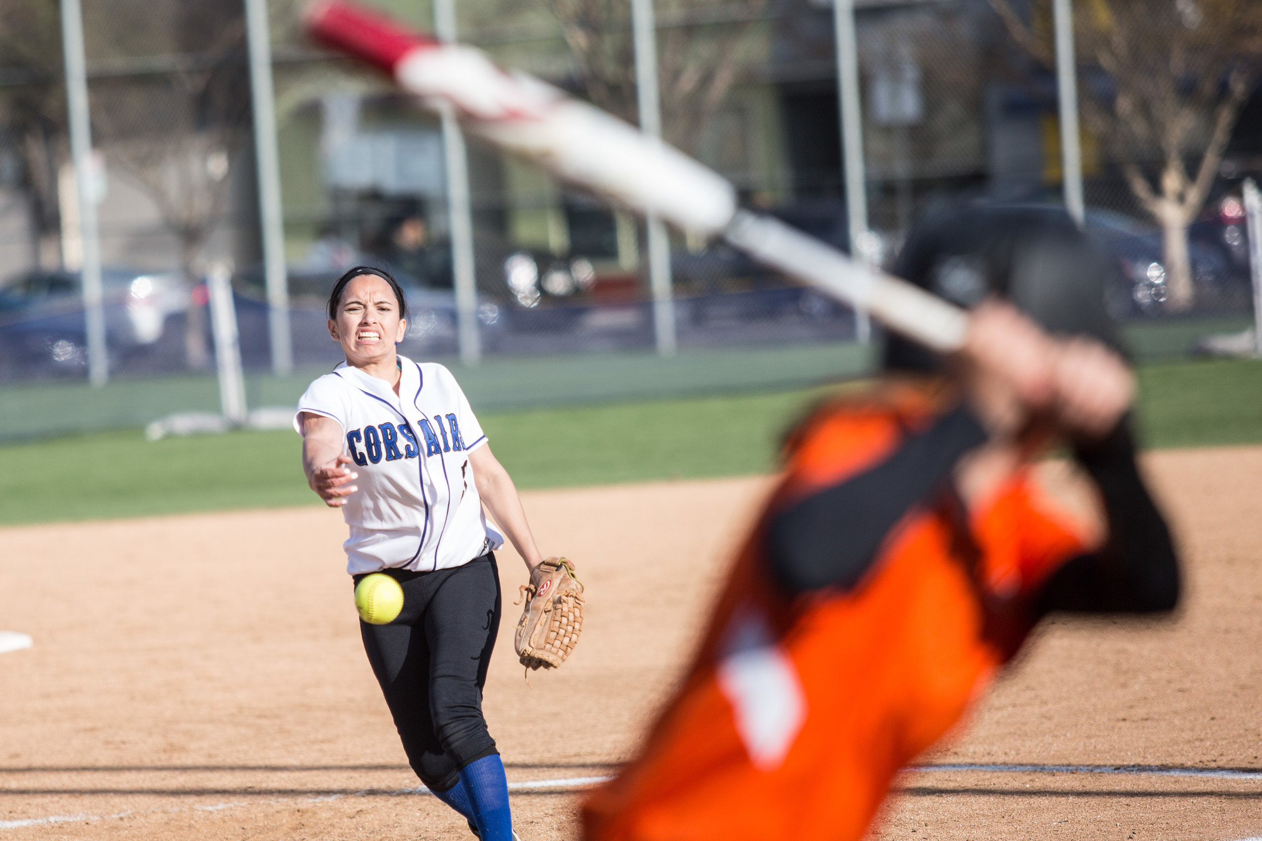 Santa Monica College Corsair freshman in-fielder Ashley Nava (#3, white) pitches a curve ball during the bottom of the third at the Corsair Field in Santa Monica, California, on Tuesday, February 27, 2018. The Corsairs would go on to lose the game 0-14 against the Ventura College Pirates. (Corsair Photo: Matthew Martin)