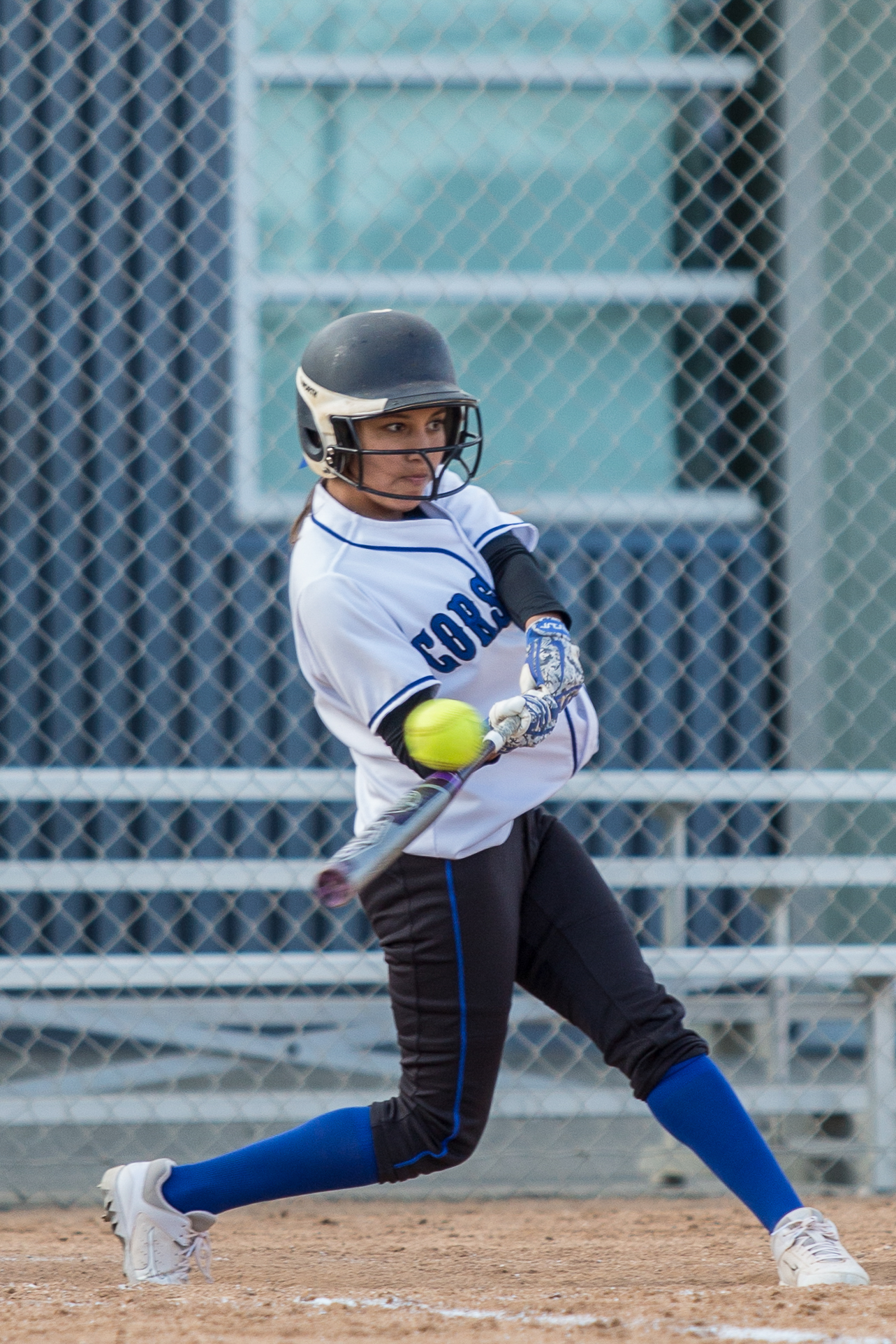 Santa Monica College freshman in-fielder Emma Soto (#80, white) hits a double at the bottom of the 4th at the Corsair Field in Santa Monica California, on Tuesday, February 27 2018. The Corsairs would go on to lose the game 0-14 against the Ventura College Pirates. (Corsair Photo: Matthew Martin)