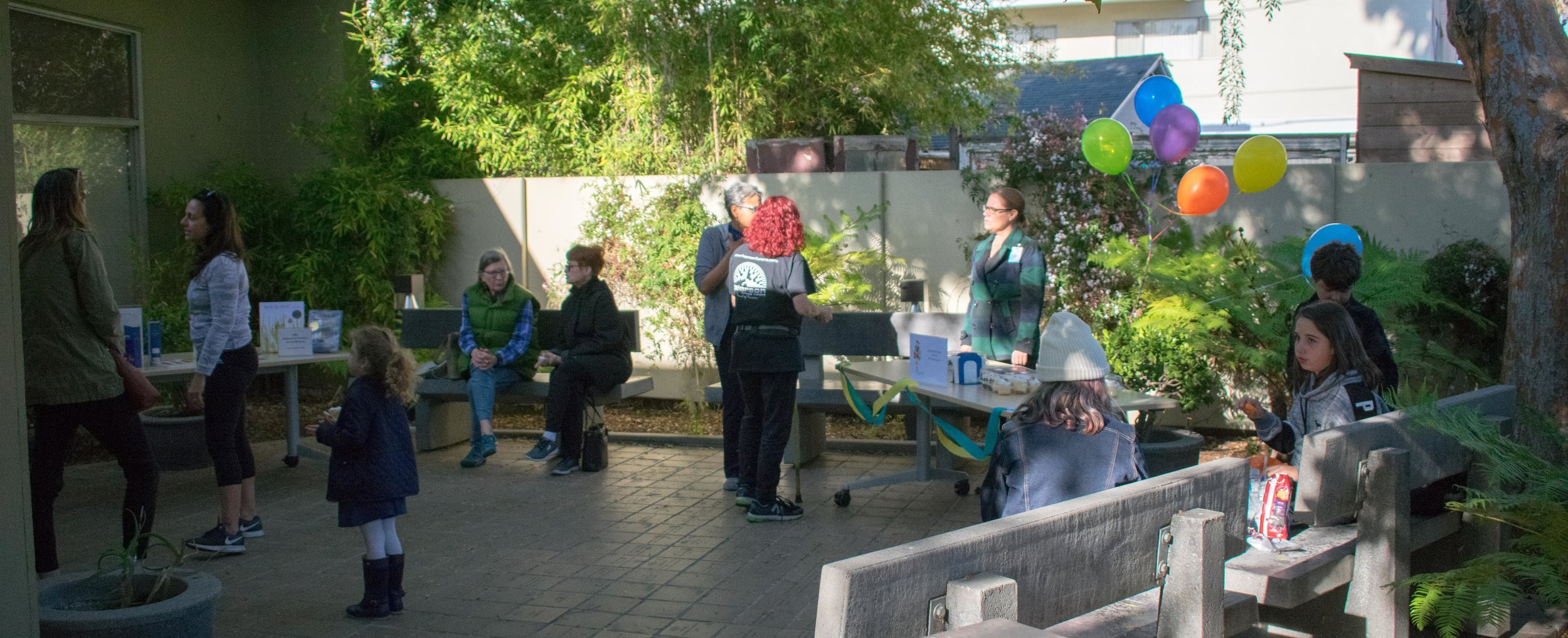 During the 58th anniversary of the Montana Avenue Branch of the Santa Monica Public Library system, patrons gather at an event held in the patio of the library in Santa Monica, California. The library helps the community around the area with many programs and resources that are available for free. March 1, 2018. (Photo by: Ethan Lauren/Corsair Staff)