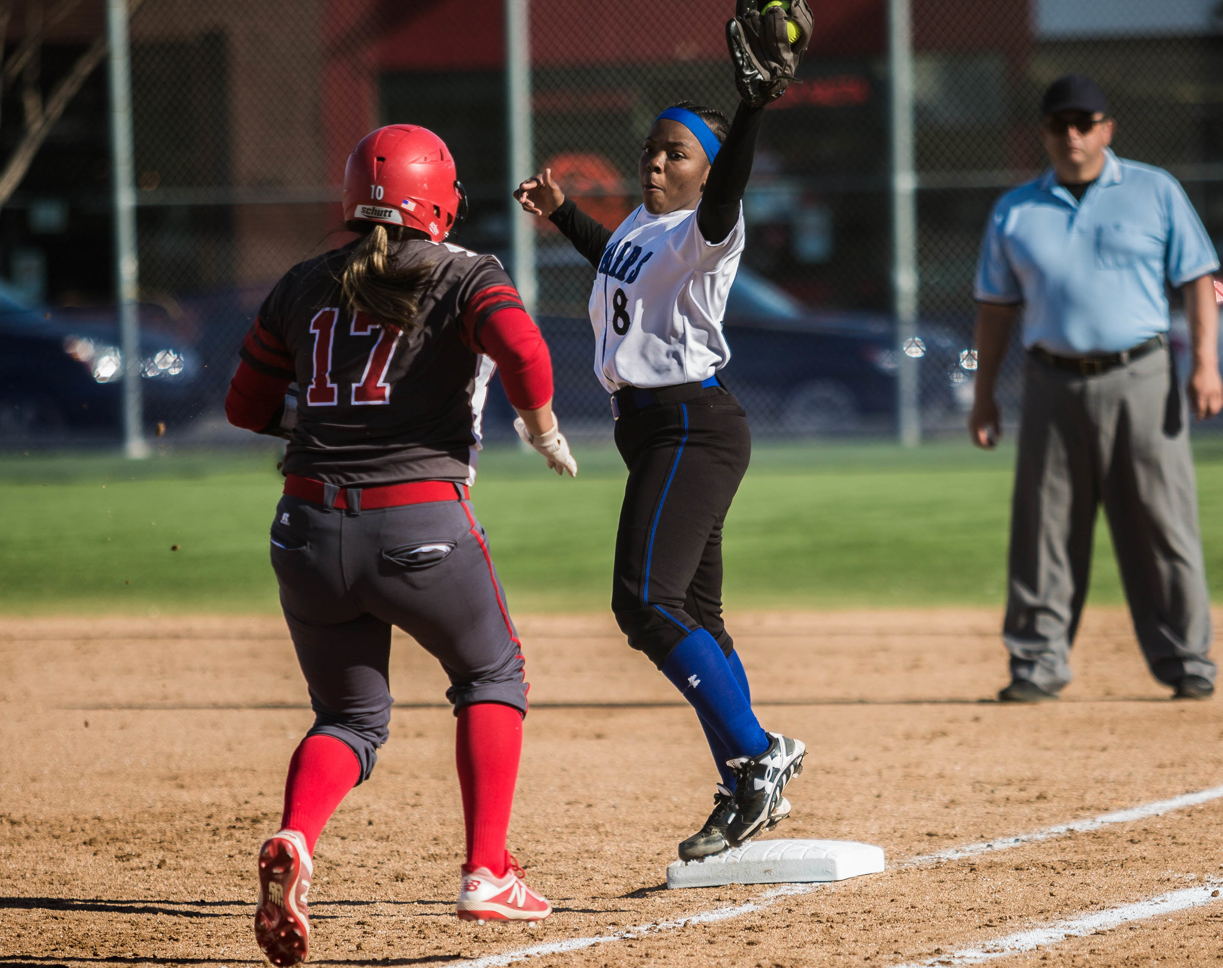 Santa Monica College Corsair freshman first base player Kahlaysia Miller #8 (right, white) successfully catches the ball thrown across the infield and tags out Bakersfield College Renegade batter Alexis Solis #17 during the bottom of the 5th inning at the Santa Monica College Corsair Field in Santa Monica California, on Tuesday, March 6, 2018. The Corsairs would go on to lose the game to Bakersfield College 0 – 9, making their tally for the season 6 wins and 11 losses. (Corsair Photo: Matthew Martin)