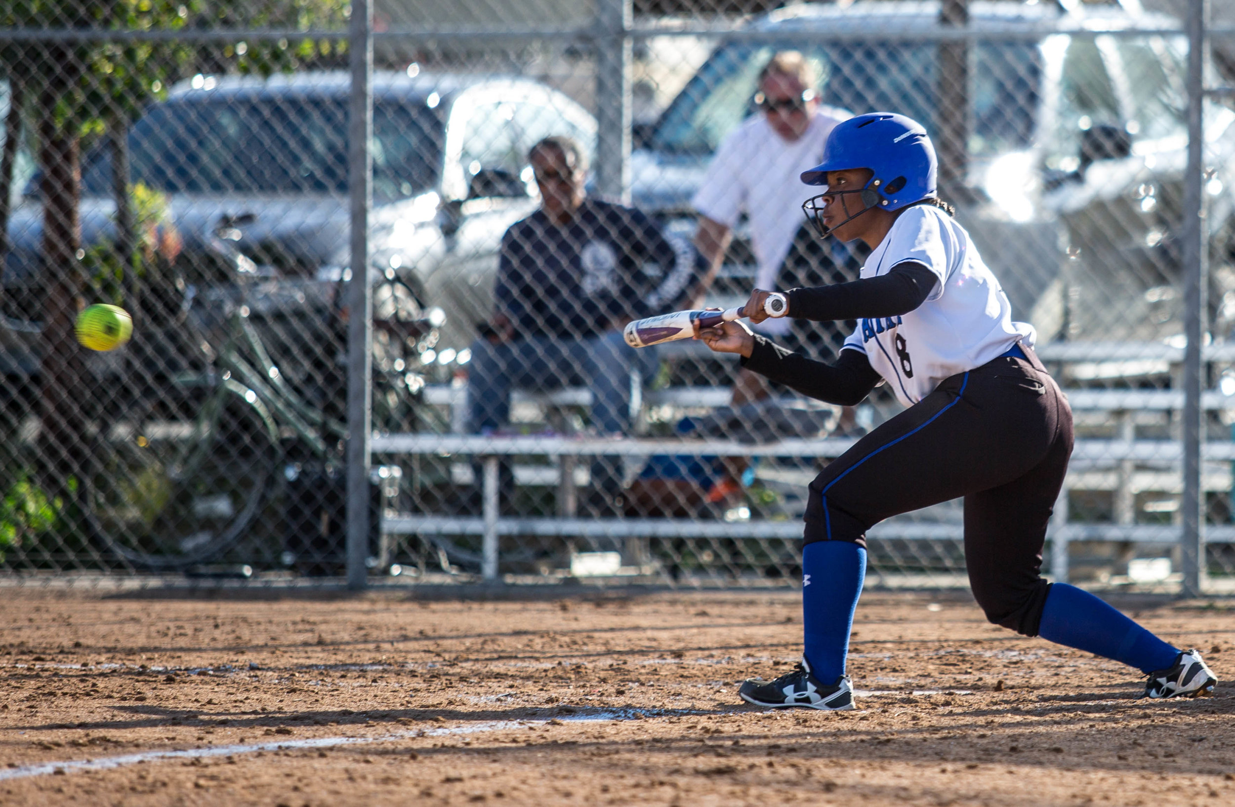 Santa Monica College Corsair batter Kahlaysia Miller #8 (left, white) successfully bunts the ball during the top of the 6th inning at the Santa Monica College Corsair Field in Santa Monica California, on Tuesday, March 6, 2018. The Corsairs would go on to lose the game to Bakersfield College 0 – 9, making their tally for the season 6 wins and 11 losses. (Corsair Photo: Matthew Martin)