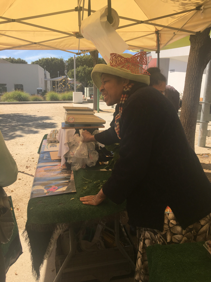 Sister Alberta reeling in customers with great enthusiasm while putting a smile on people's faces at the JF Organic Farms stand at the Santa Monica Farmers Market in Virginia Avenue Park on March 3, 2018 in Santa Monica, Calif. (Photo by: Claudia Vardoni)