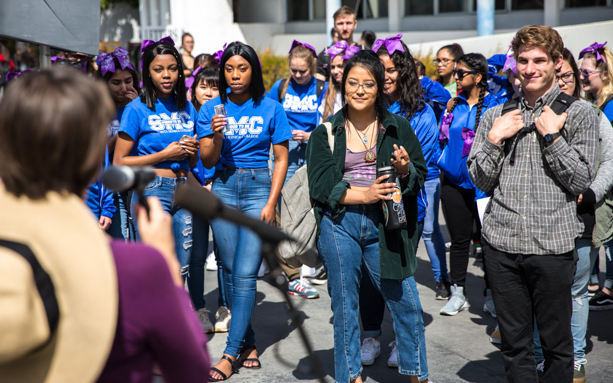 Attendees of the Santa Monica College (SMC) International Women's Day listen to Director of Student Assistance, SMC Women's Day organizer, and key speaker Ana Laura Paiva (cq) during Santa Monica College International Women's Day event that took place on the SMC main campus, in front of the Library Walkway, in Santa Monica California on Thursday, March 8, 2018. Paiva welcomed all the attendees of the Women's Day event to come up and share inspirational stories about the inspirational women in their lives and to celebrate the women in the SMC community. (Corsair Photo: Matthew Martin)