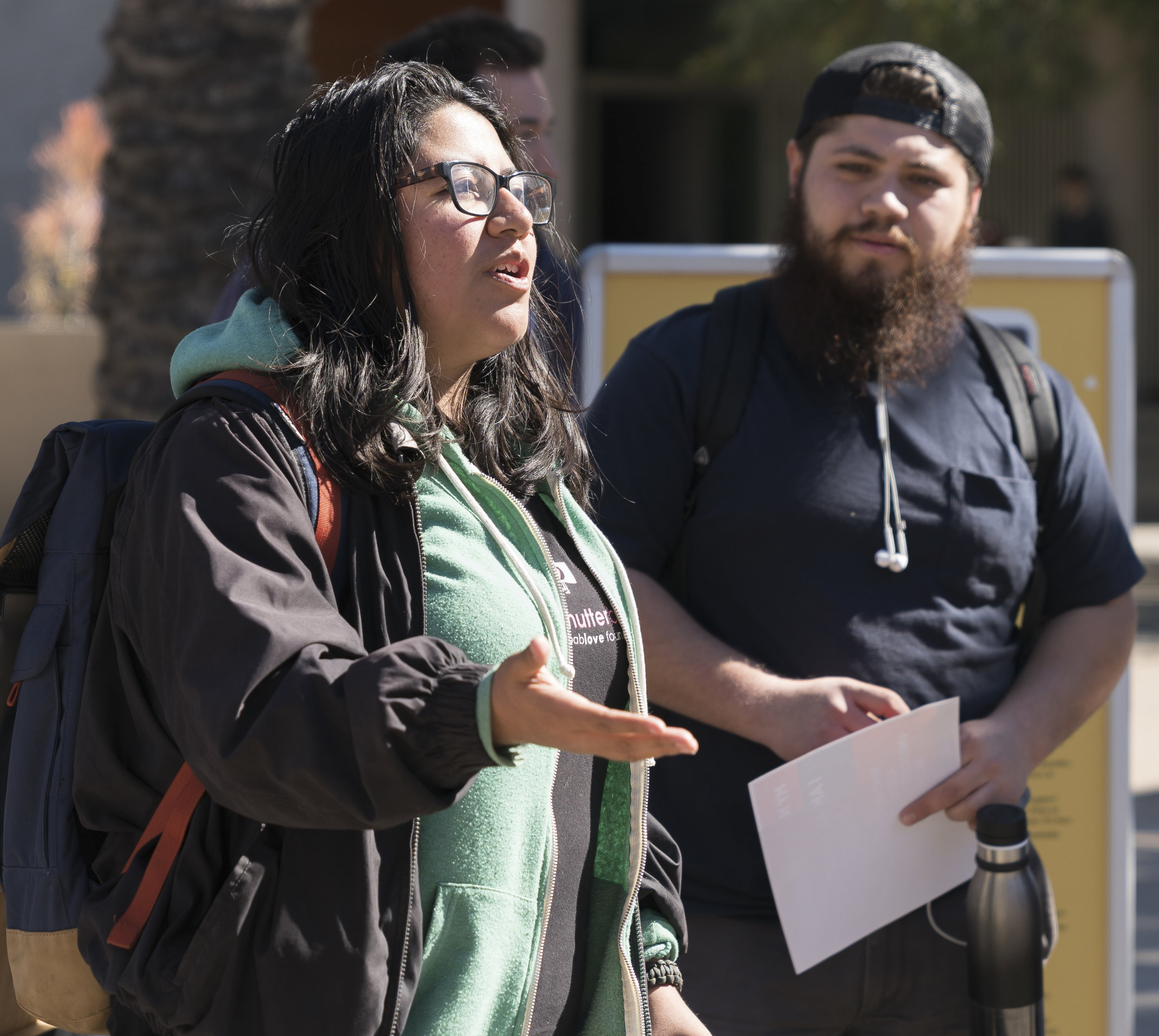 "Santa Monica College student Andrea Ramos (left) speaks at a DACA Day of Action gathering on Monday, March 5, 2018 at SMC's main campus in Santa Monica, Calif. as fellow student Delfino Martinez (right) listens. Ramos, 25, an undocumented student who was not financially able to apply for DACA benefits when the program was first announced under then-President Barack Obama, said she always saw signs on campus of SMC standing behind other nationla events. ""This is the first time I feel supported by SMC [as an undocumented student without DACA status],"" she said.   (Photo: Helena Sung)"