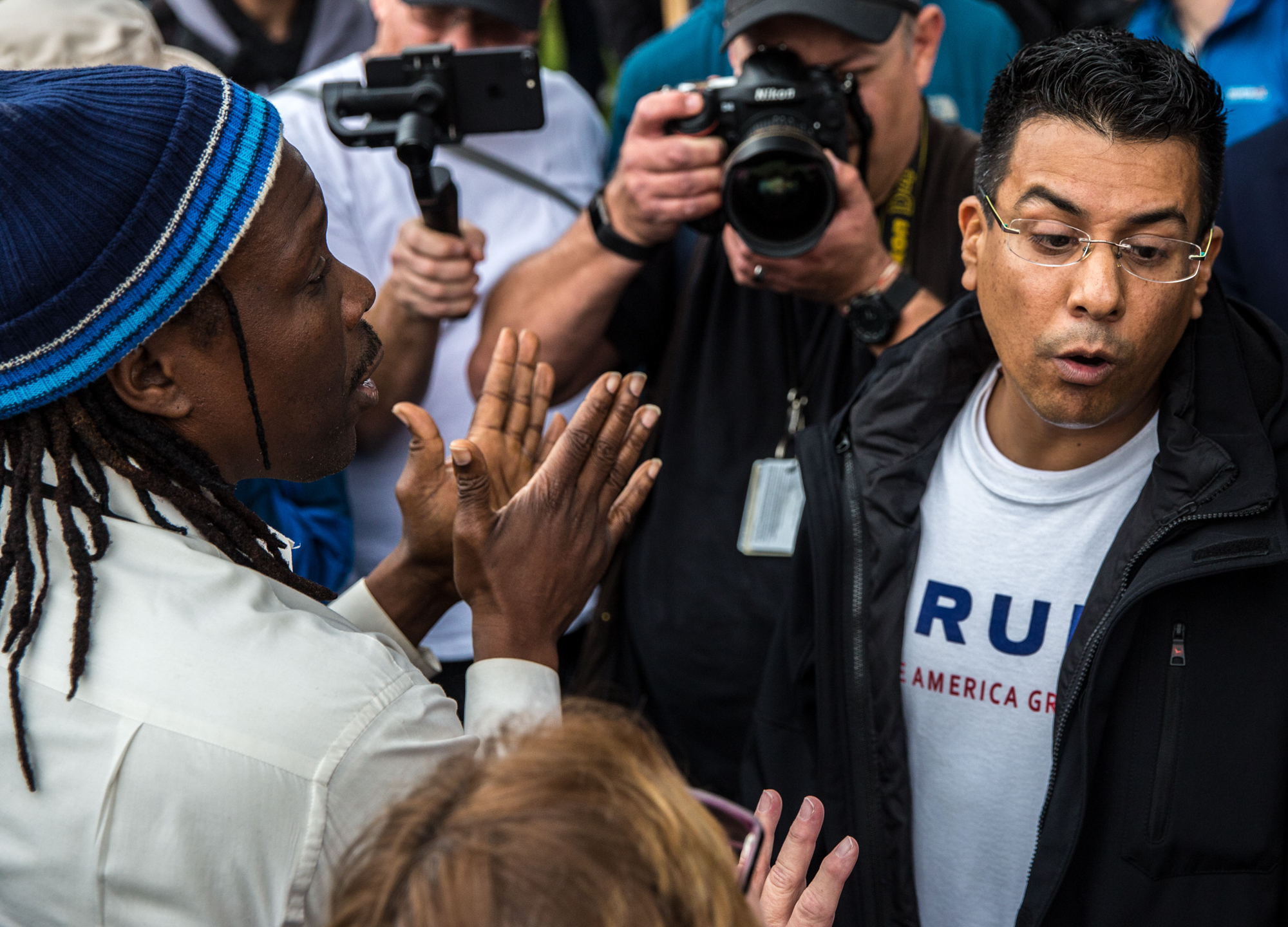 A President Donald J., Trump Supporter Danny Rodriguez (right) and anti Trump Pastor Cue Jn-Marie (left), a former Virgin Records rapper, turned evangelist discuss the civil rights movement peacefully at Beverly Gardens Park during a anti-Trump protest in Beverly Hills, California, on March 13, 2018. As President Donald Trump made his way to a fundraiser in Beverly Hills, protesters were there to greet him with their dissent during Tuesdays protest. (Photo by: Matthew Martin)