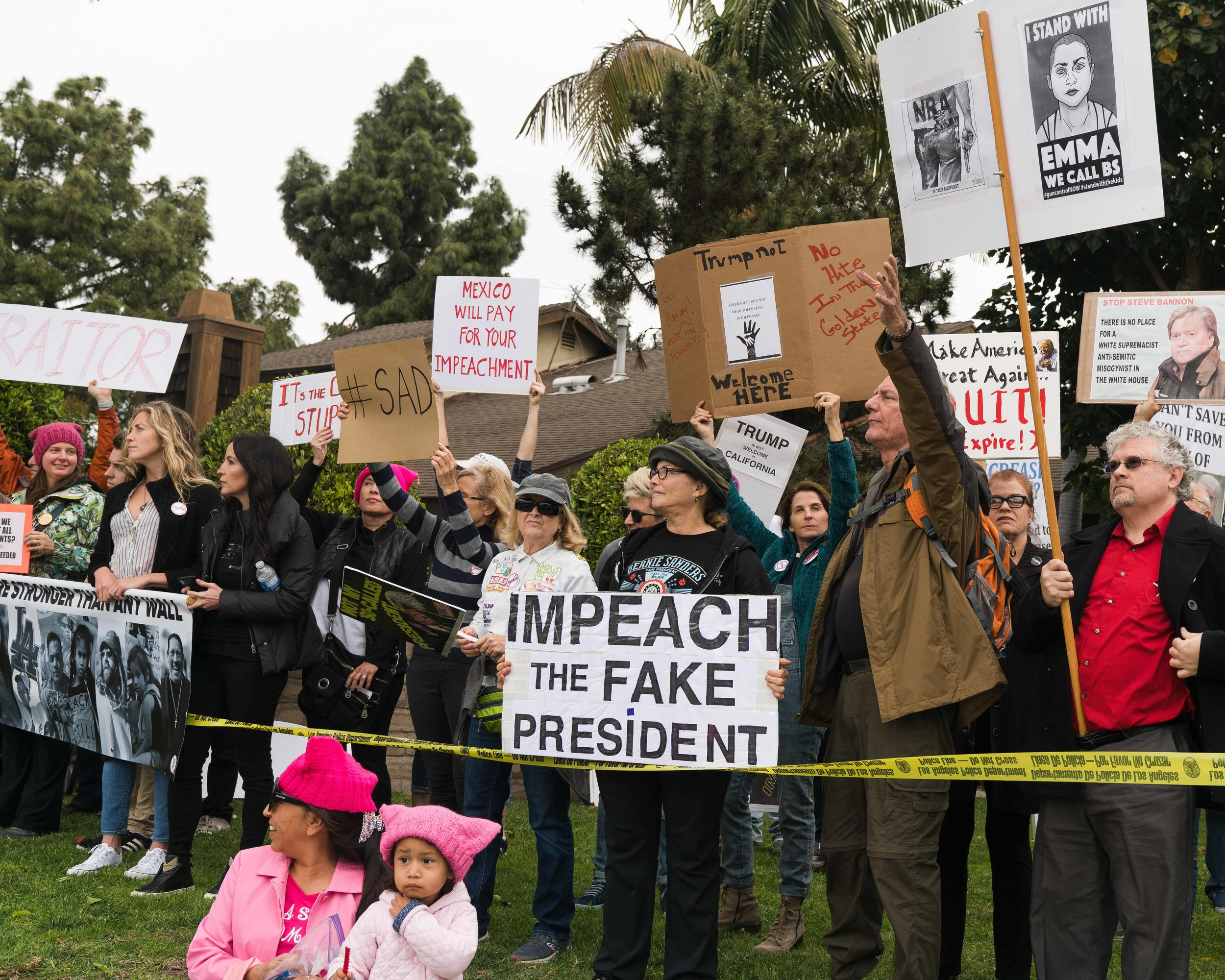 """Protesters gather near Ocean Park Blvd and Centinela Avenue in Santa Monica, California on Tuesday, March 13, 2018 to protest the arrival of President Donald Trump. """"I feel like he's trespassing,"""" says Venice resident, Chris Blanch. (Helena Sung / Corsair Photo)"""