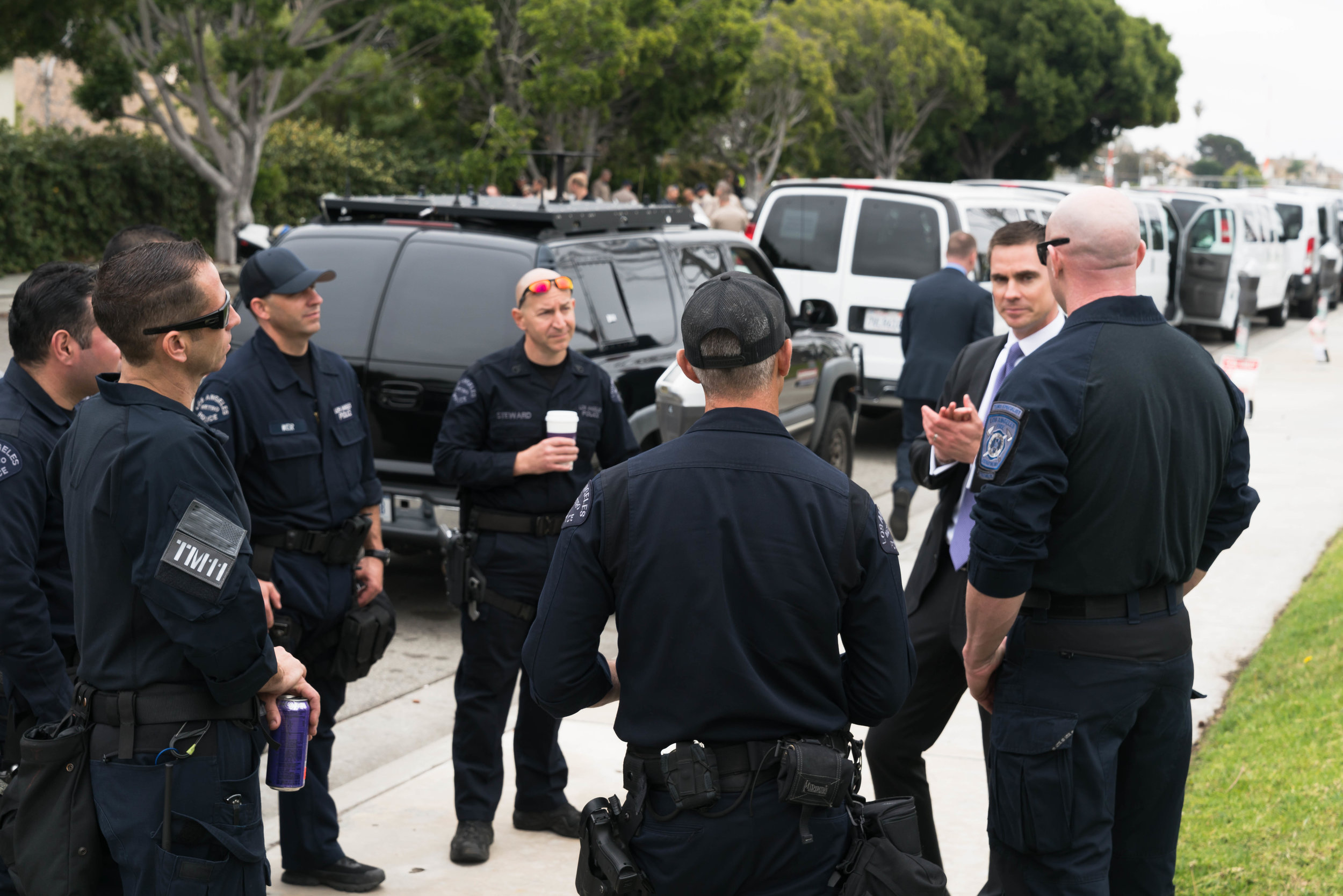 A US Secret Service official talks with members of the Los Angeles Fire and Police Departments shortly before President Donald Trump's arrival at Santa Monica Airport in Santa Monica, California on Tuesday, March 13, 2018. It was Trump's first visit to California since taking office in January 2017. (Helena Sung / Corsair Photo)