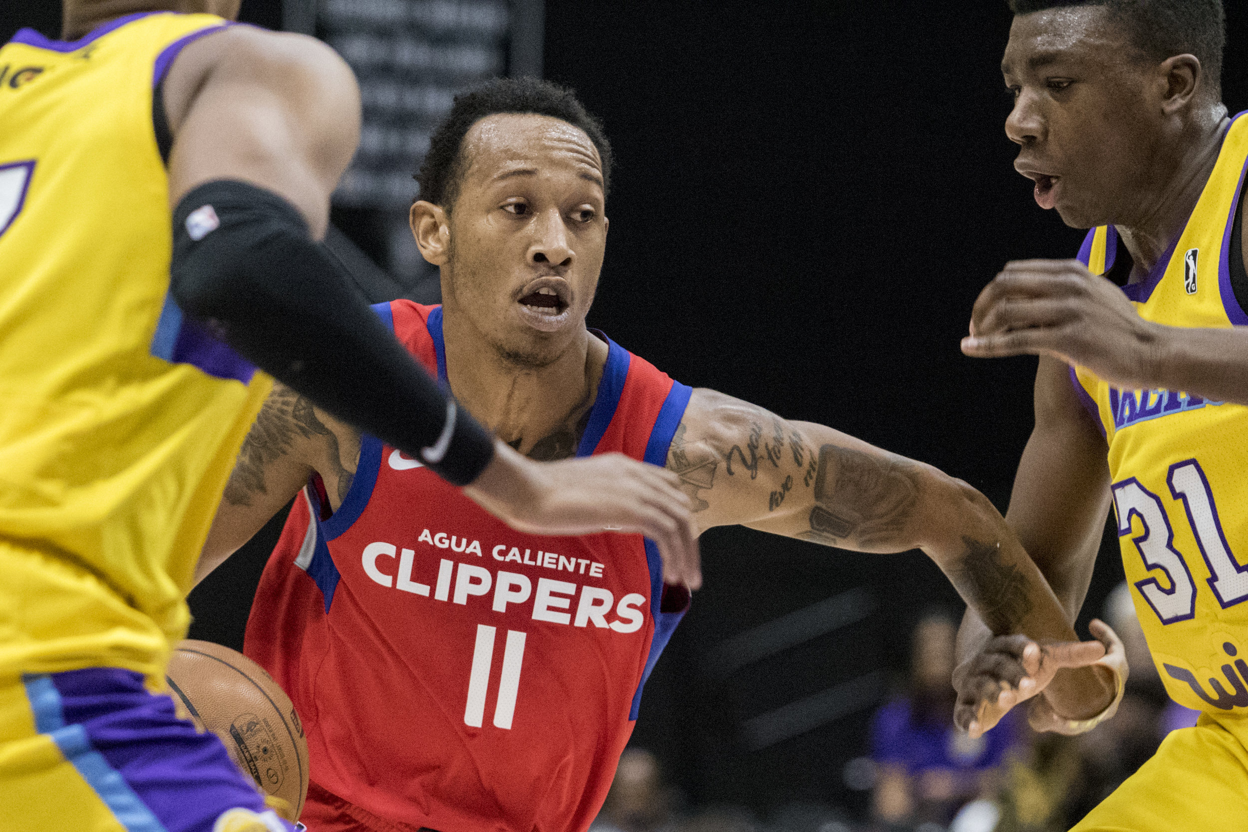 Agua Caliente Clippers guard Tim Quarterman (11, middle) drives to the basket against the South Bay Lakers during their Gatorade League game on March 16, 2017 at the UCLA Health Stadium in El Segundo,California. The Lakers won 108-104. (Zane Meyer-Thornton/Corsair Photo)