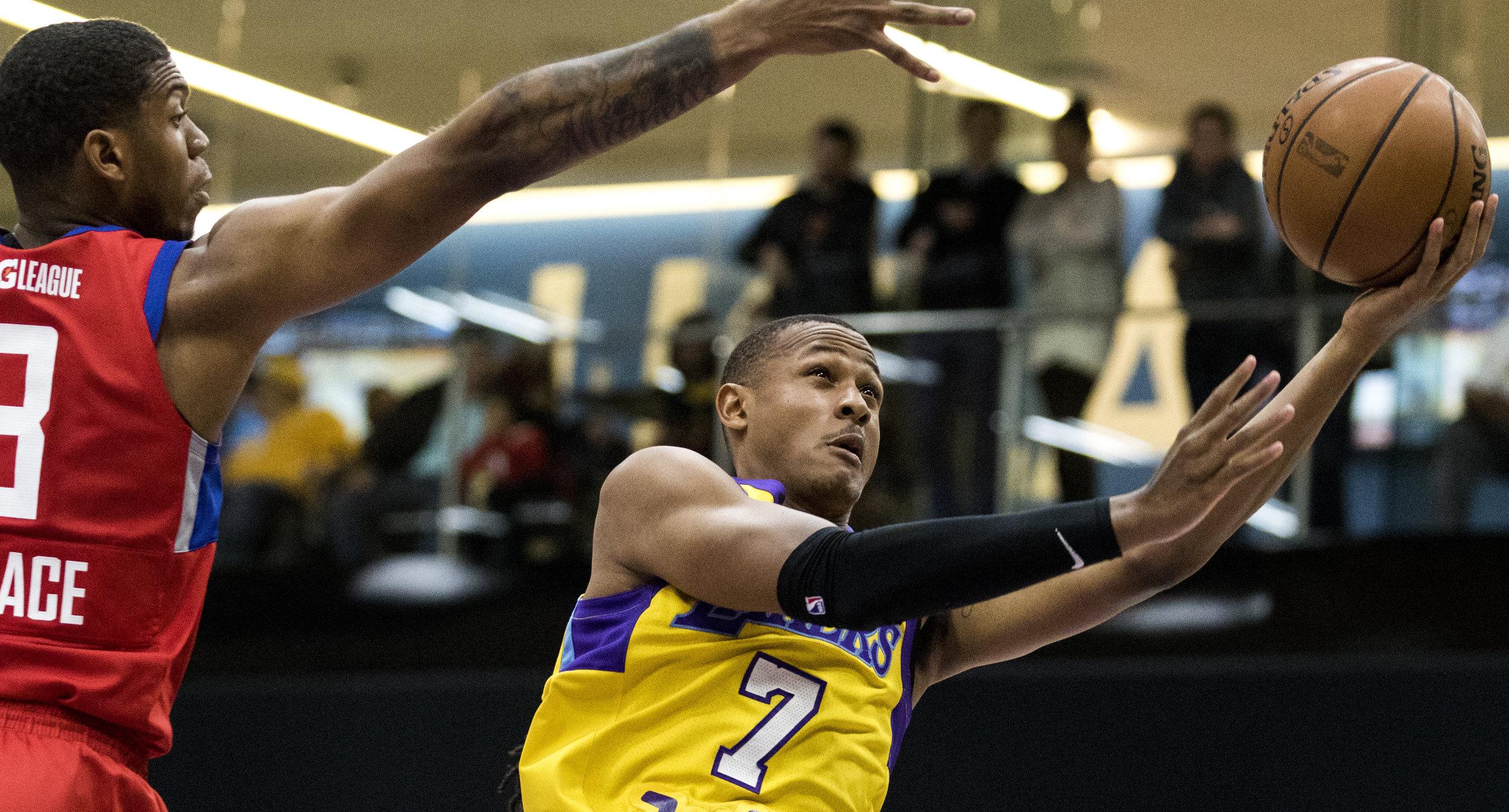 South Bay Lakers guard Demarcus Holland (7, right) goes for a lay up while Agua Caliente Clippers guard Tyrone Wallace (3, left) attempts to block the shot during their Gatorade League game on March 16, 2017 at the UCLA Health Stadium in El Segundo,California. The Lakers won 108-104. (Zane Meyer-Thornton/Corsair Photo)