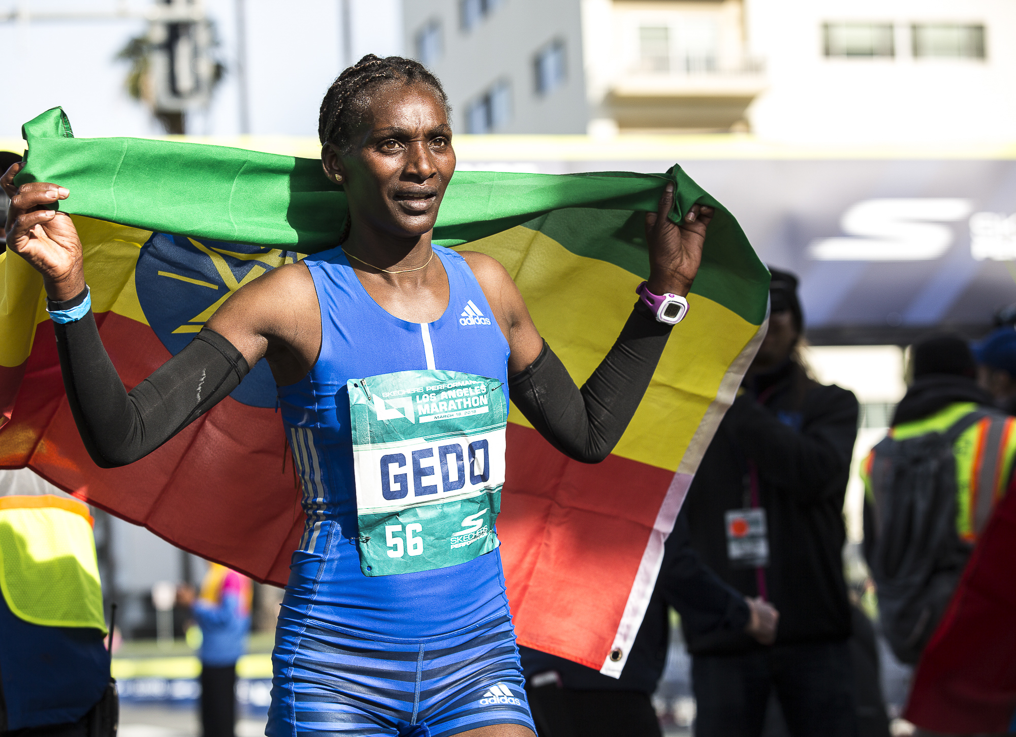 Sule Gedo, the first women to cross the finish line at 2:33:52, proudly holds the Ethiopian flag during the 33rd annual Los Angeles Marathon event on March 18, 2018 in Santa Monica, California. (Matthew Martin/Corsair Photo)