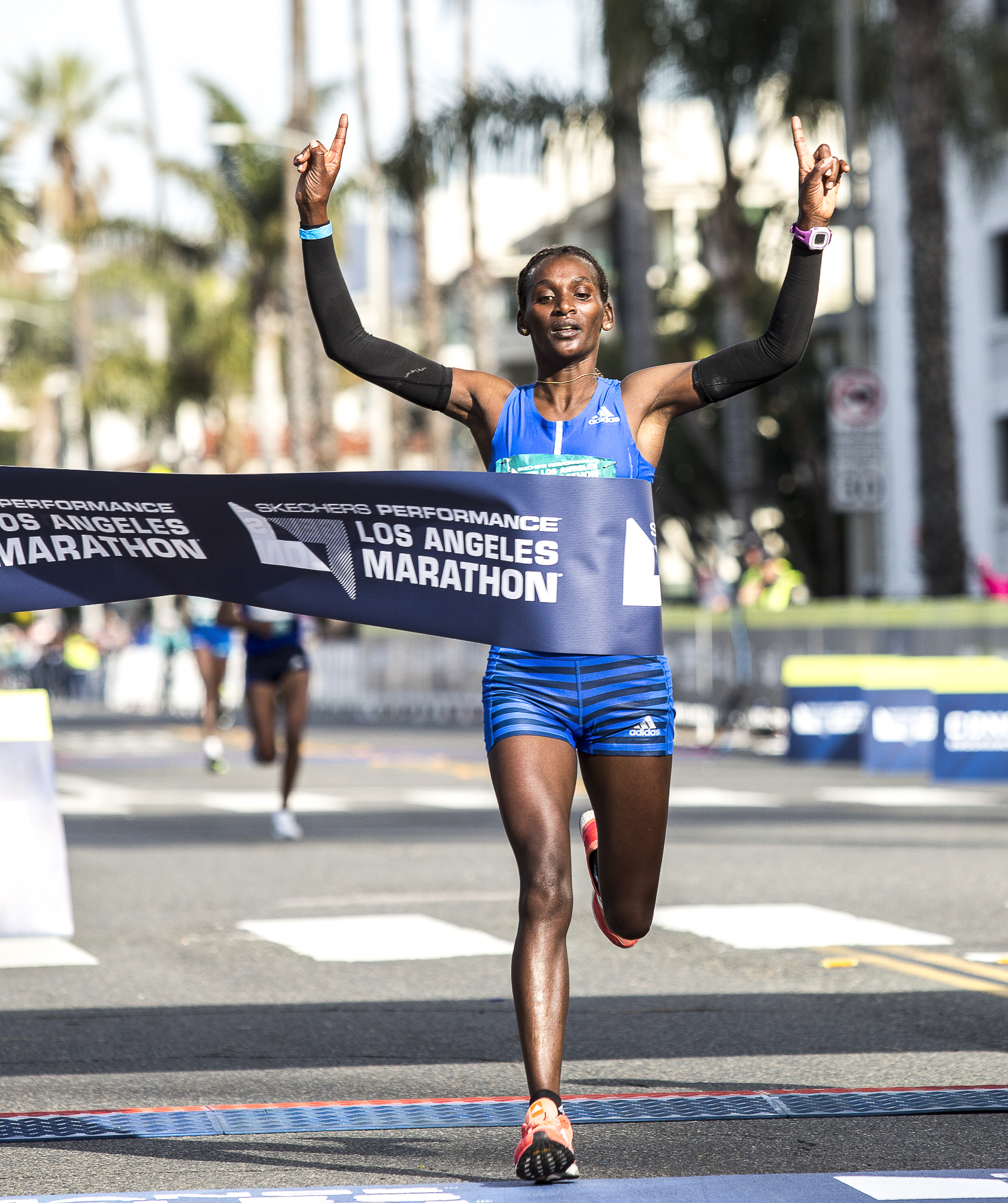 Sule Gedo crosses the finish line, wining the pro-women's 33rd annual Los Angeles Marathon event with a time of 2:33:50 on March 18, 2018 in Santa Monica, California. (Matthew Martin/Corsair Photo)