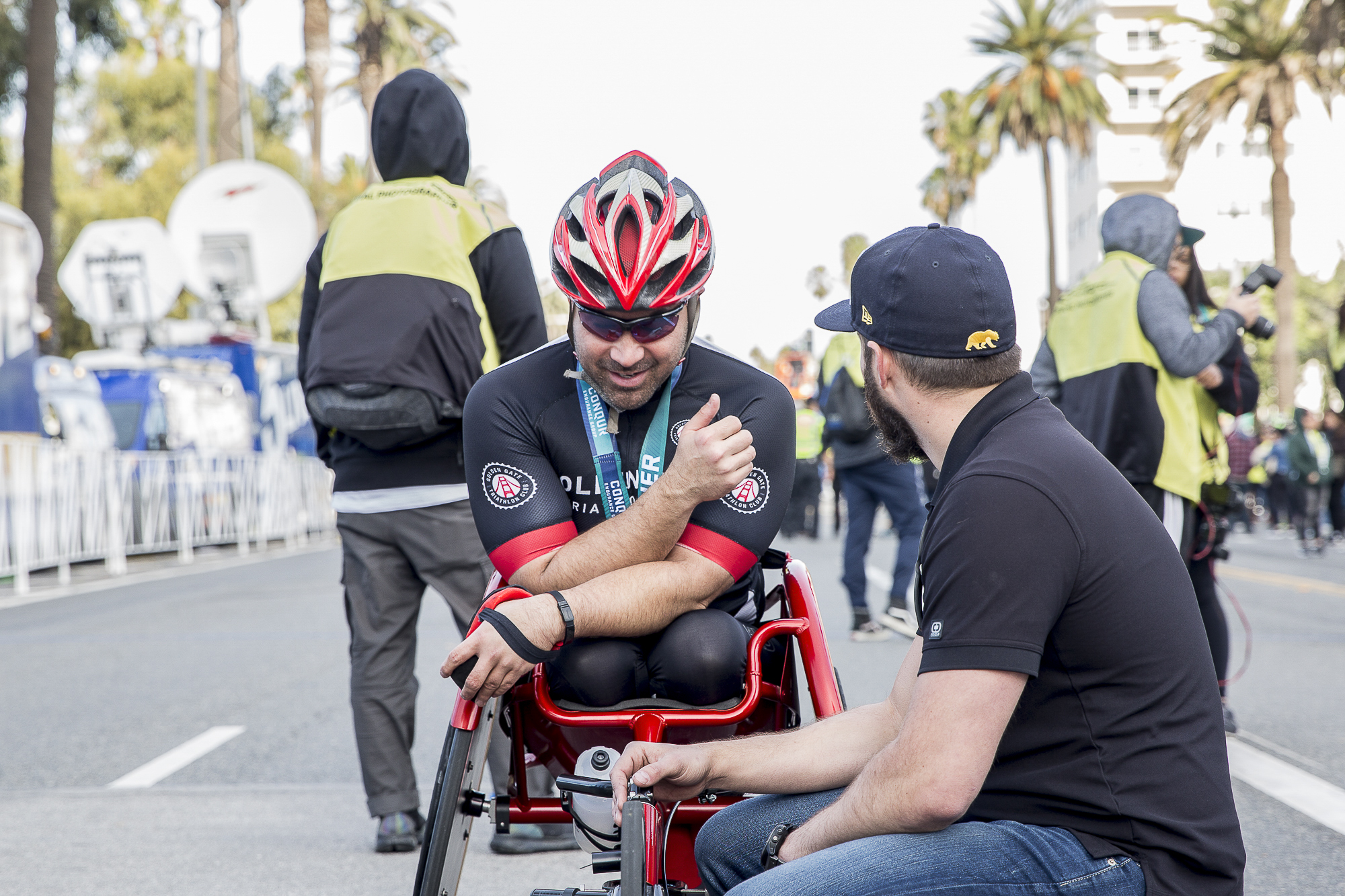 Franz Walkup (bib # 309) discusses the race with a friend of his after completing the 33rd annual Los Angeles Marathon with a final time of 1:59:54 in Santa Monica, California on Sunday, March 18 2018. (Matthew Martin/Corsair Photo)