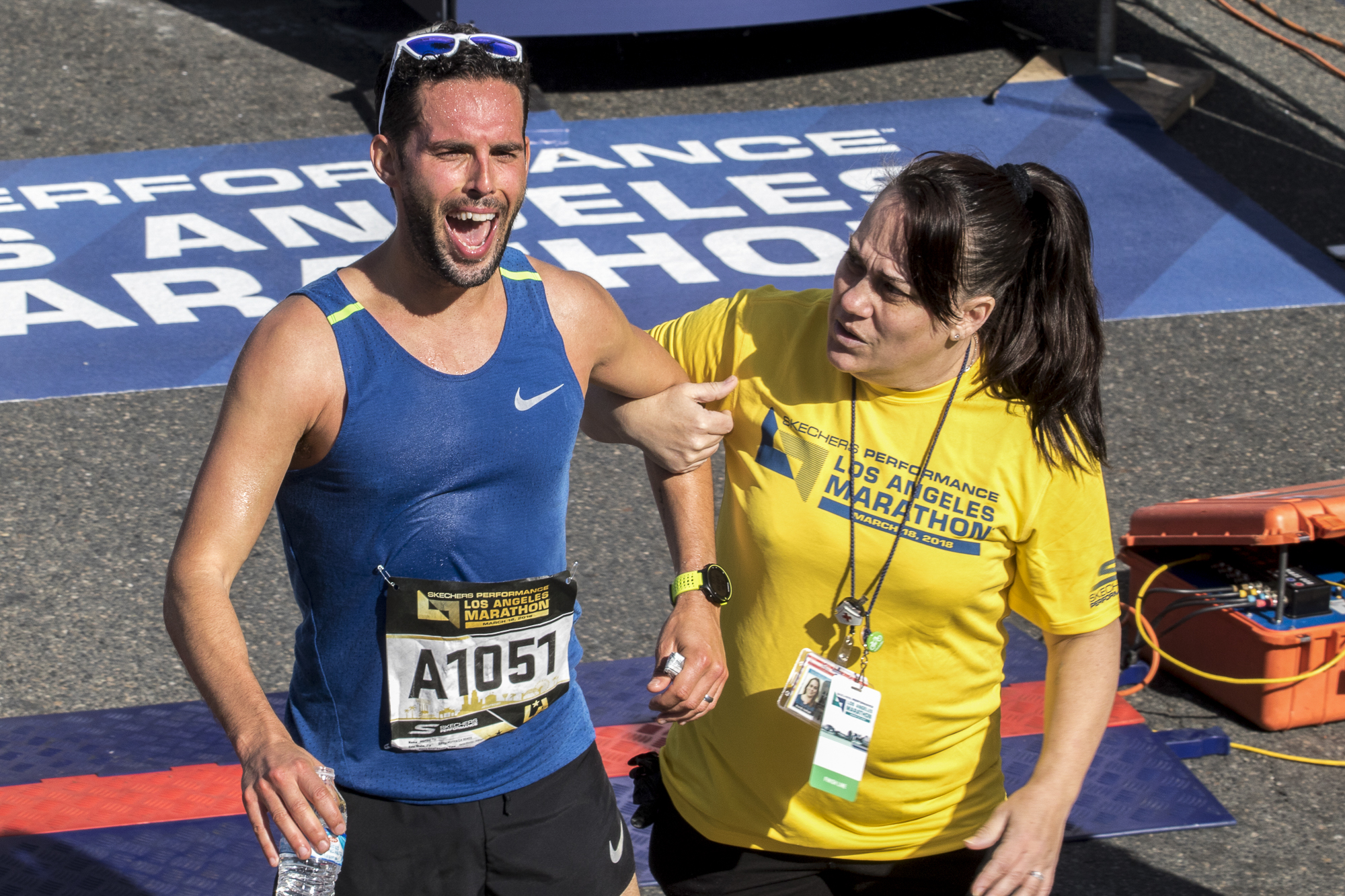 Santa Monica resident Michael Till (left) finishes the Los Angeles Marathon in Santa Monica, California and is grabbed by one of the many volunteer Hotwalkers who were on standby incase any runners needed emergency medical attention. The 2018 Los Angeles Marathon took place on March 18, 2018. (Zane Meyer-Thornton/Corsair Photo)