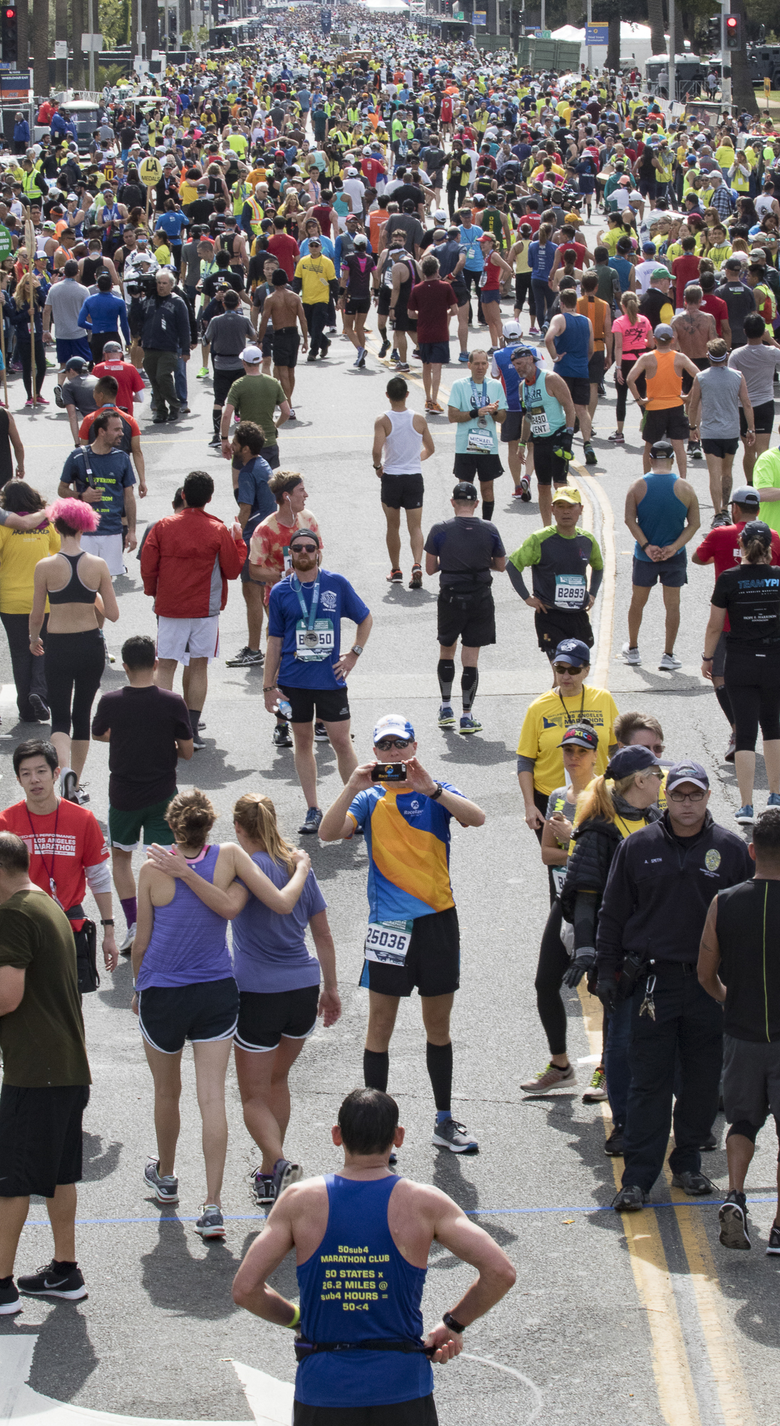 Mike Sohaskey takes a video recording on his cell phone after finishing the 2018 Los Angeles Marathon on March 18, 2018 in Santa Monica, California. (Zane Meyer-Thornton/Corsair Photo)