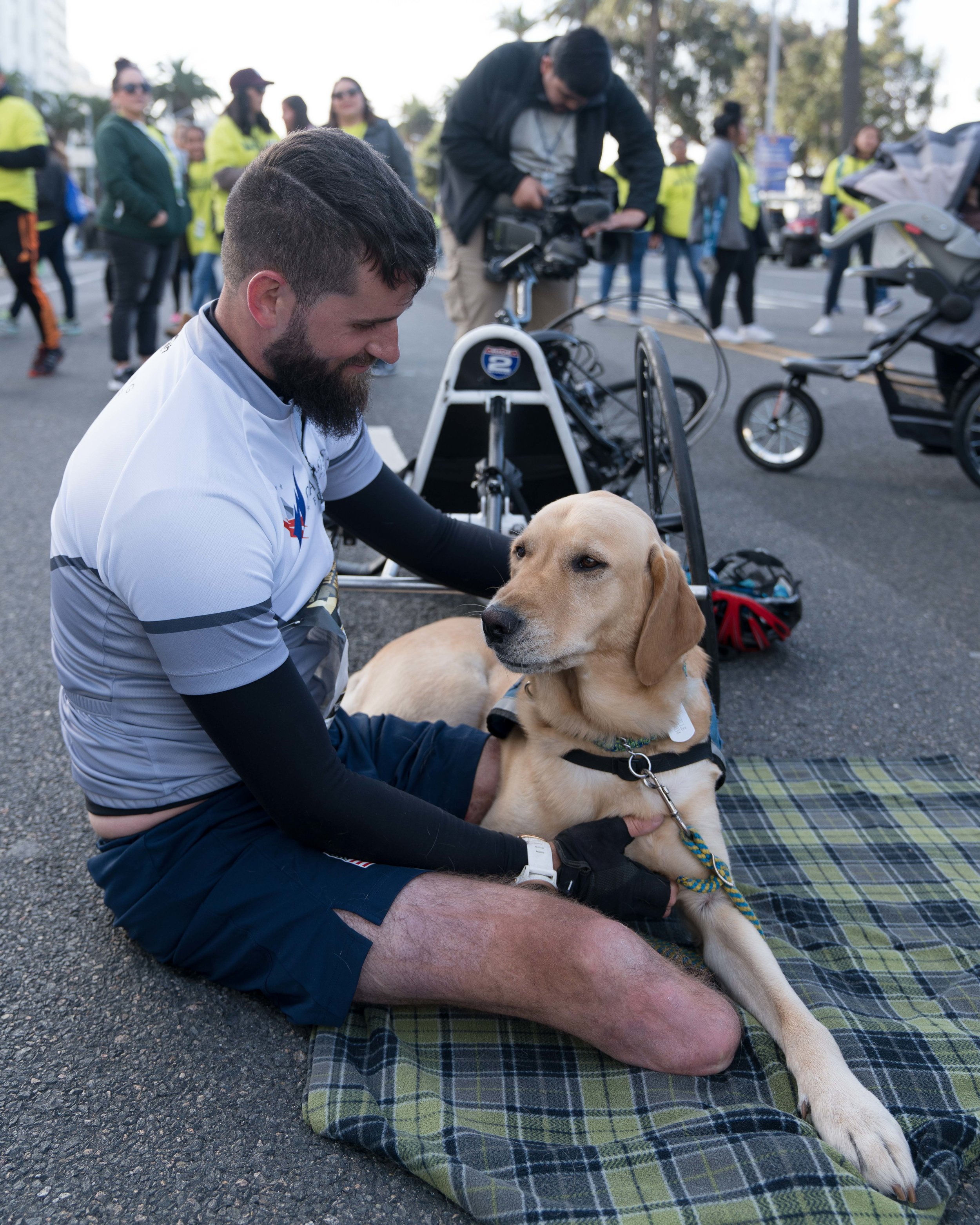 Stefan Leroy, 26, a retired United States Army Sergeant, competed as a wheelchair runner in the Los Angeles Marathon in Santa Monica, California on Sunday, Marhc 18, 2018. Leroy lost both his legs in an explosion while serving in Afghanistan in 2012. His service dog, Knoxville, helps him with daily activities. (Photo by: Helena Sung).