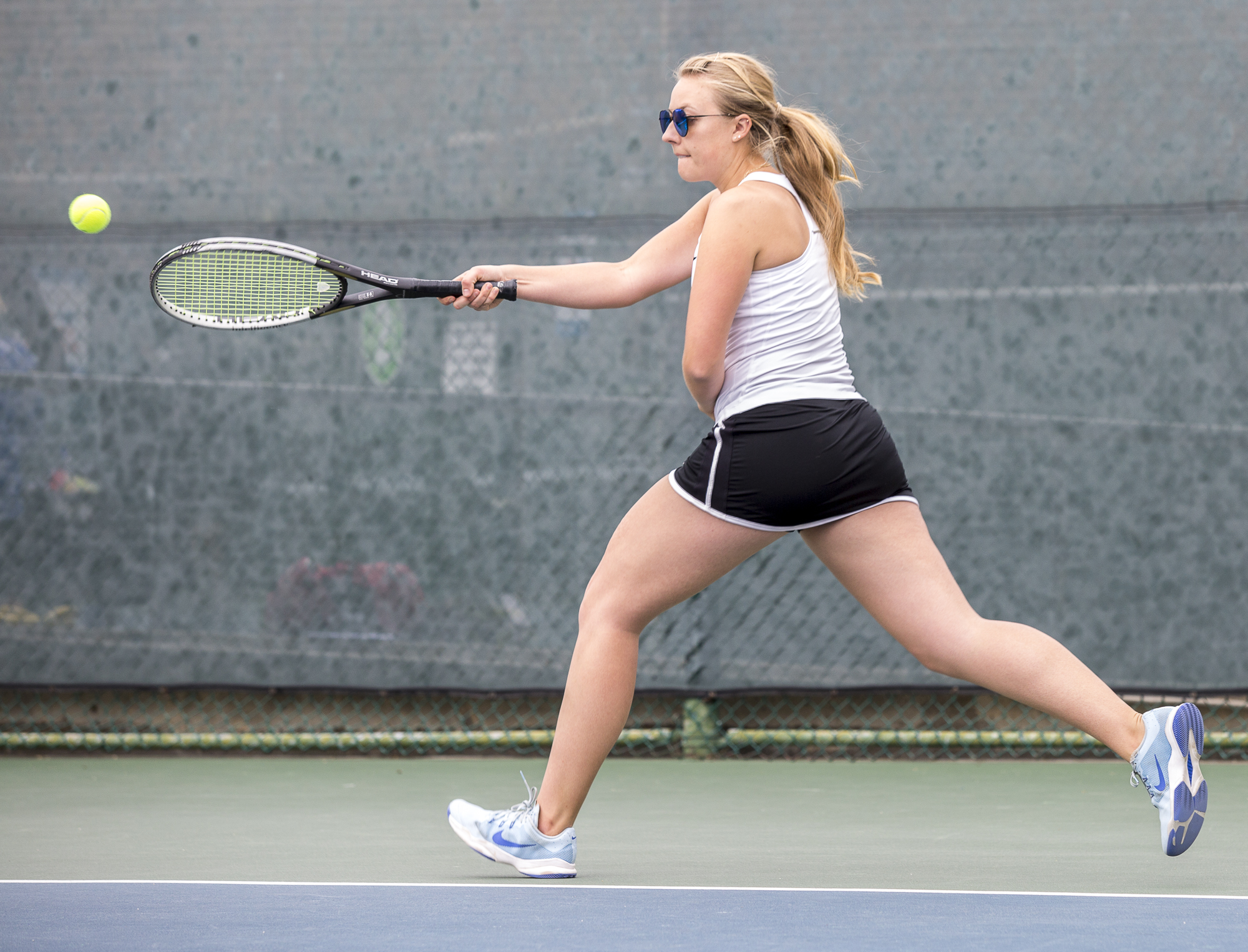 Santa Monica College Corsair Amanda Golling (#3, singles) prepares for a powerful, forehand swing against her Glendale City College Vaquero opponent at the Ocean View Park Tennis Courts in Santa Monica, California on Tuesday, March 20 2018. Golling would go on to lose both sets of her game, 0-2, adding to the Corsairs 0-7 loss against the Glendale College Vaqueros. (Matthew Martin/Corsair Photo)