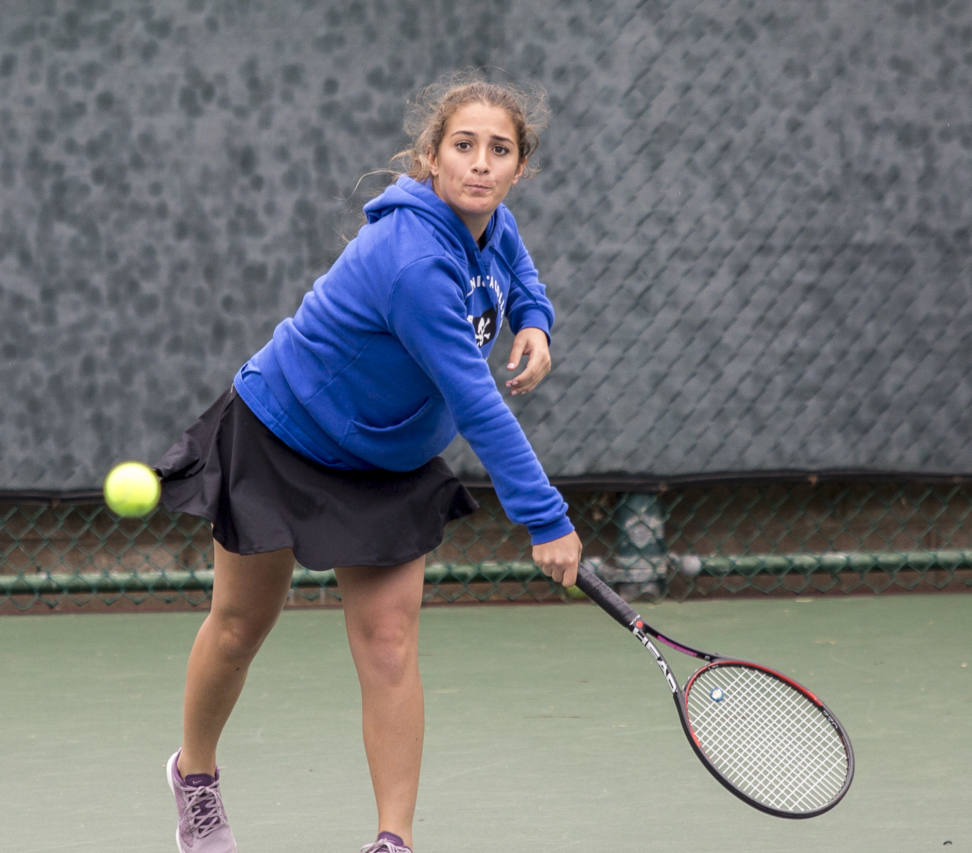 Santa Monica College Corsair freshman Mina Girit (#1, doubles) serves the ball conservatively during her doubles match against her Glendale City College Vaquero opponents consisting of sophomore Srna Lepchevska (cq) and sophomore Hailey McNall (cq) at the Ocean View Park Tennis Courts in Santa Monica, California on Tuesday, March 20 2018. The single set that Girit and her partner played consisted of a 2 – 8 set loss, which contributed to the 0-6 match loss for the team. (Matthew Martin/Corsair Photo).